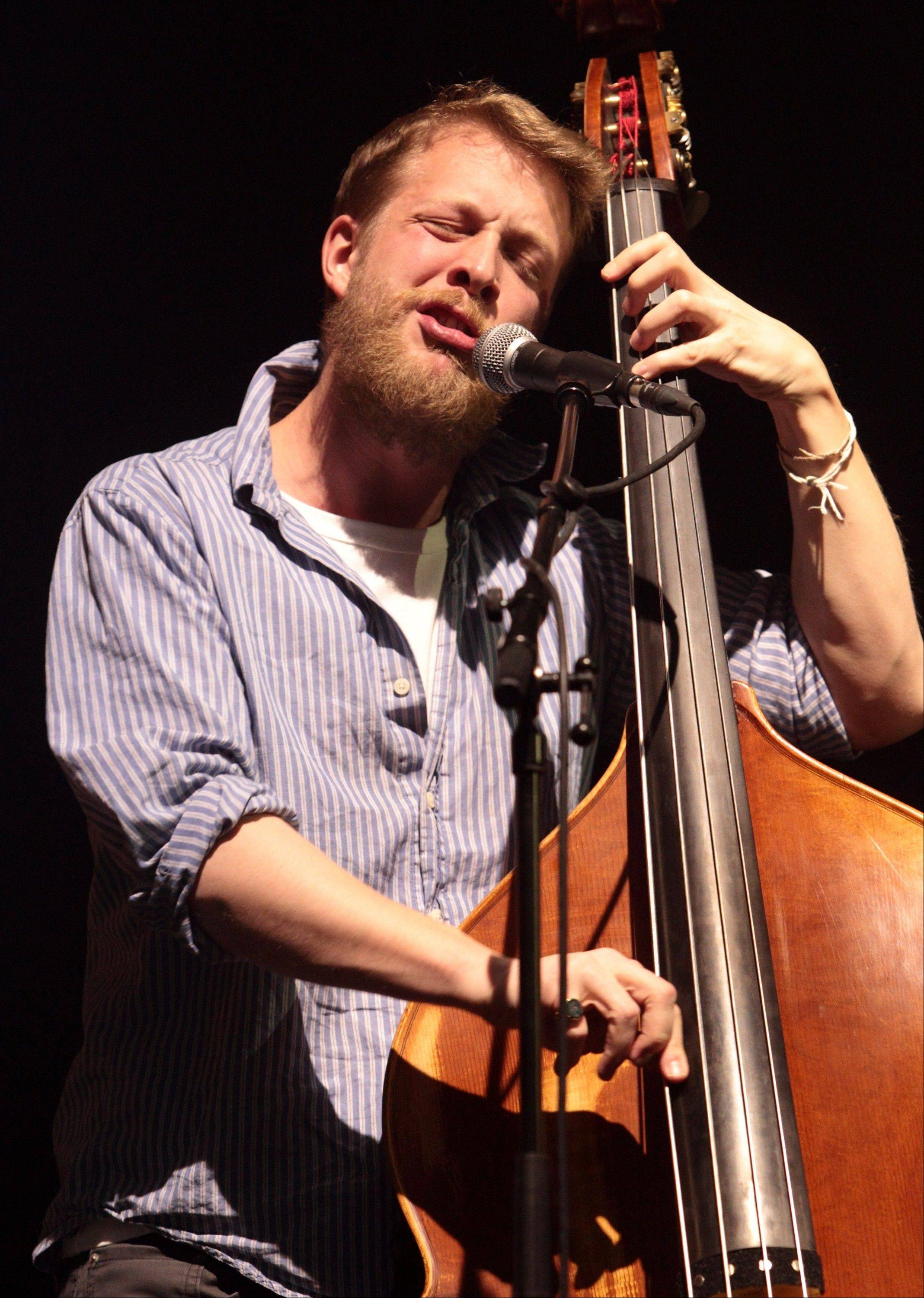 Ted Dwane, of the English folk rock band Mumford & Sons, performs at the Susquehanna Bank Center in Camden, N.J. Mumford & Sons on Thursday announced it has canceled its headlining performance at Bonnaroo Music & Arts Festival in Tennessee. The decision comes after Dwane received treatment this week for a blood clot on his brain.