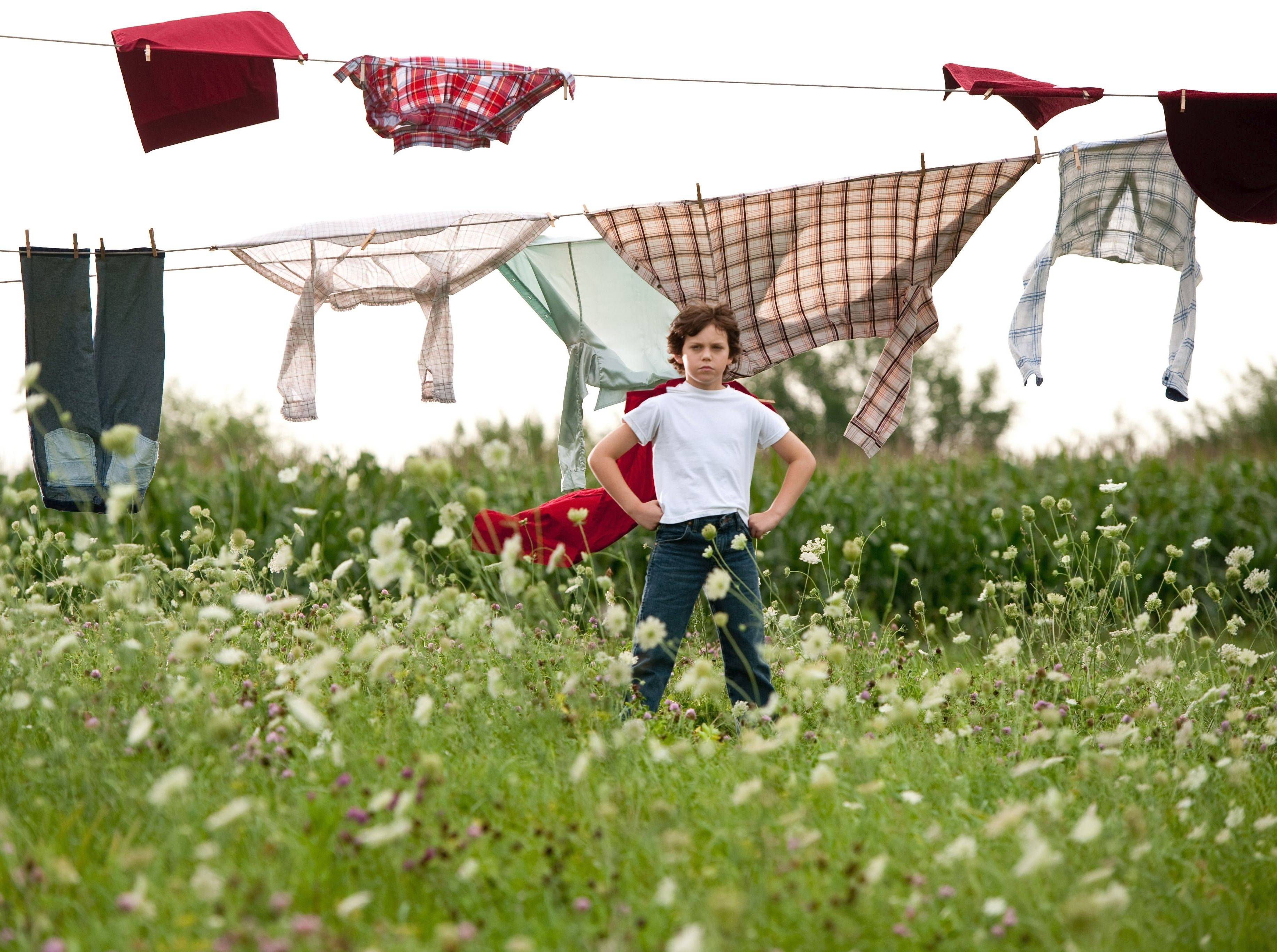 "Young Clark Kent (Cooper Timberline) foreshadows his future super self on a farm in Oswego during ""Man of Steel."""