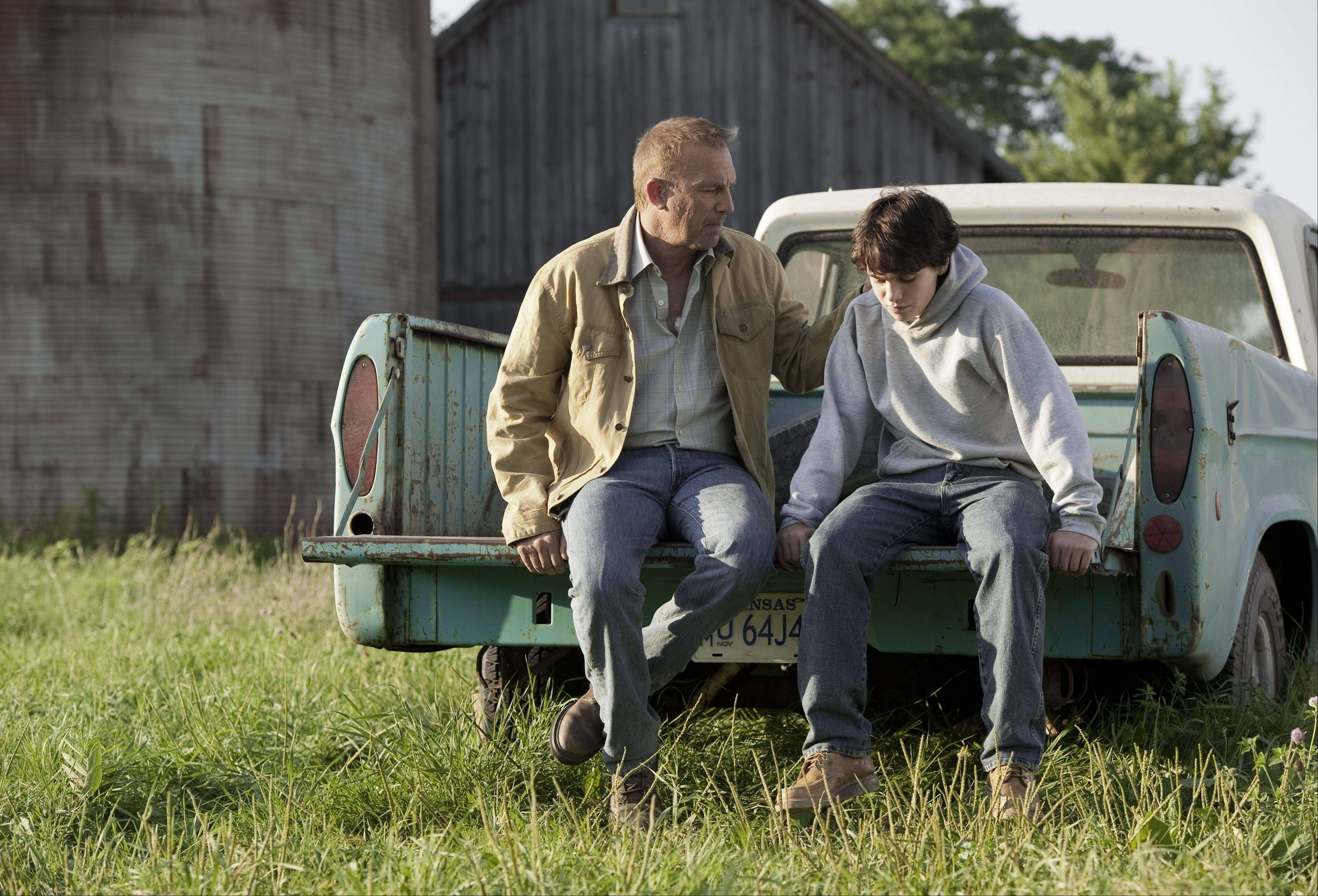 Jonathan Kent (Kevin Costner), left, comforts his son Clark (Dylan Sprayberry) on the family farm -- a scene shot in Oswego.