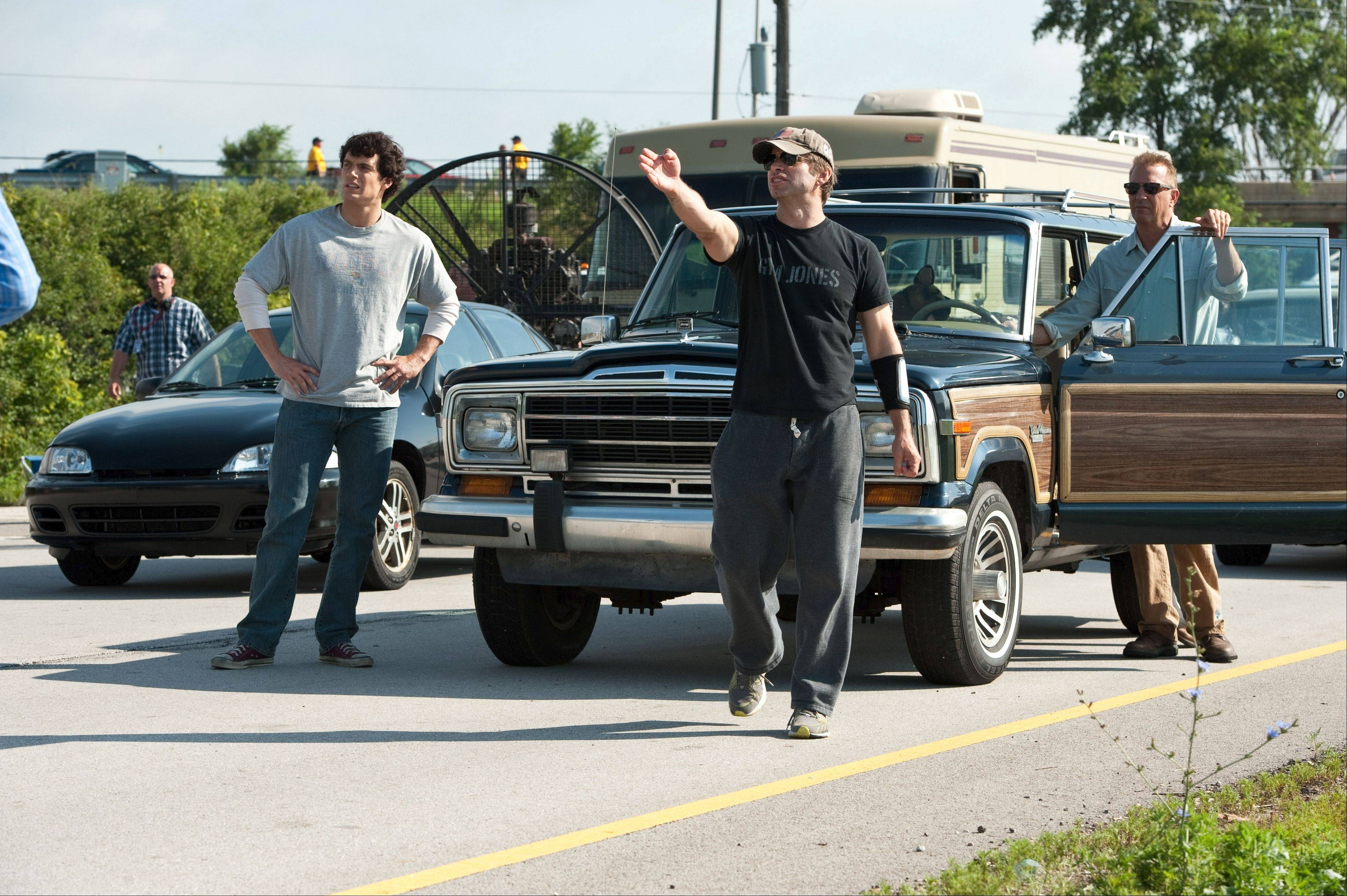 "Zack Snyder (center) directs a scene from ""Man of Steel"" in Sugar Grove. Star Henry Cavill stands to his left."