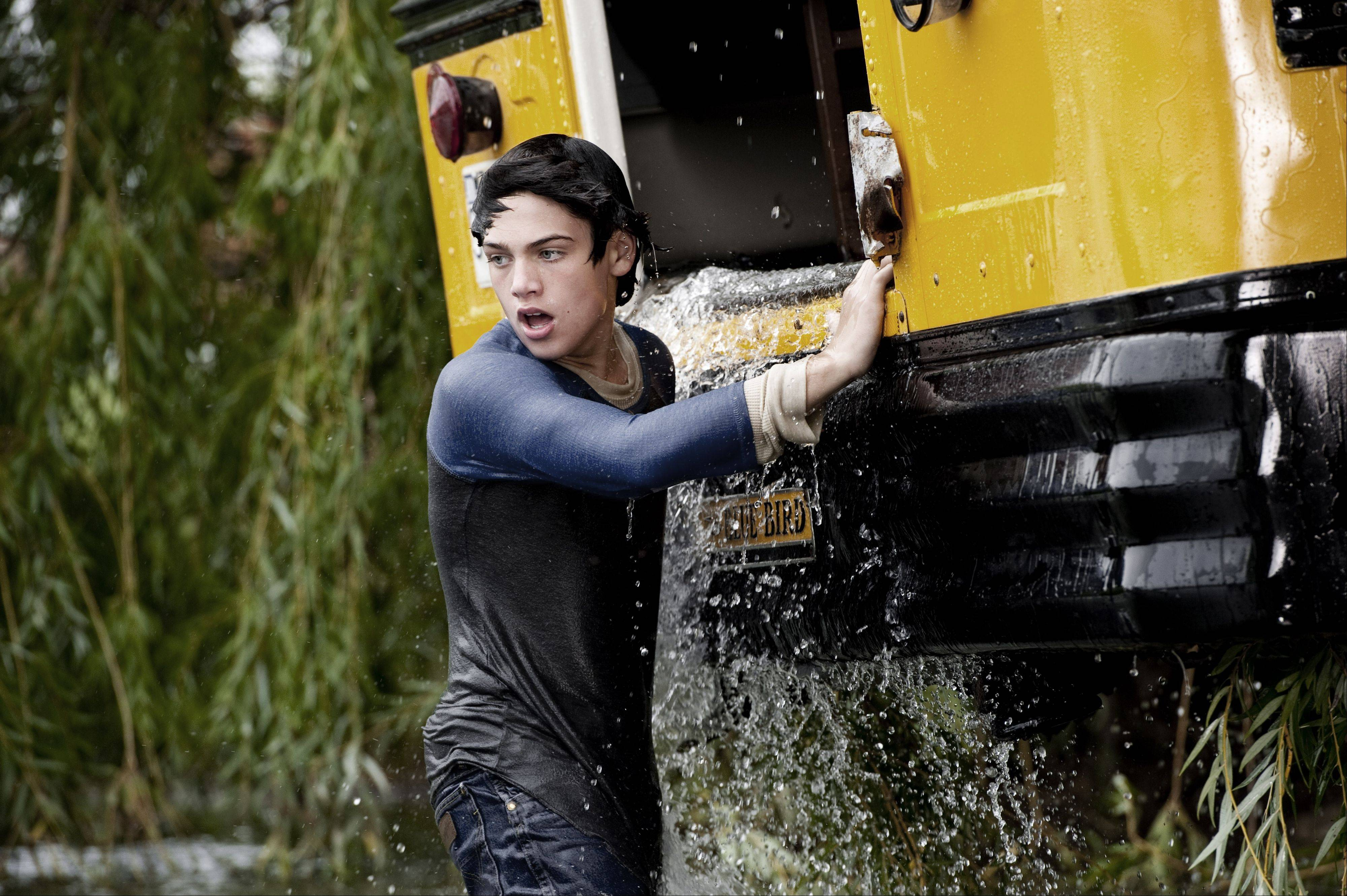 "Young Clark Kent (Dylan Sprayberry) saves a school bus full of students on location in suburban LaSalle County in the movie ""Man of Steel."""