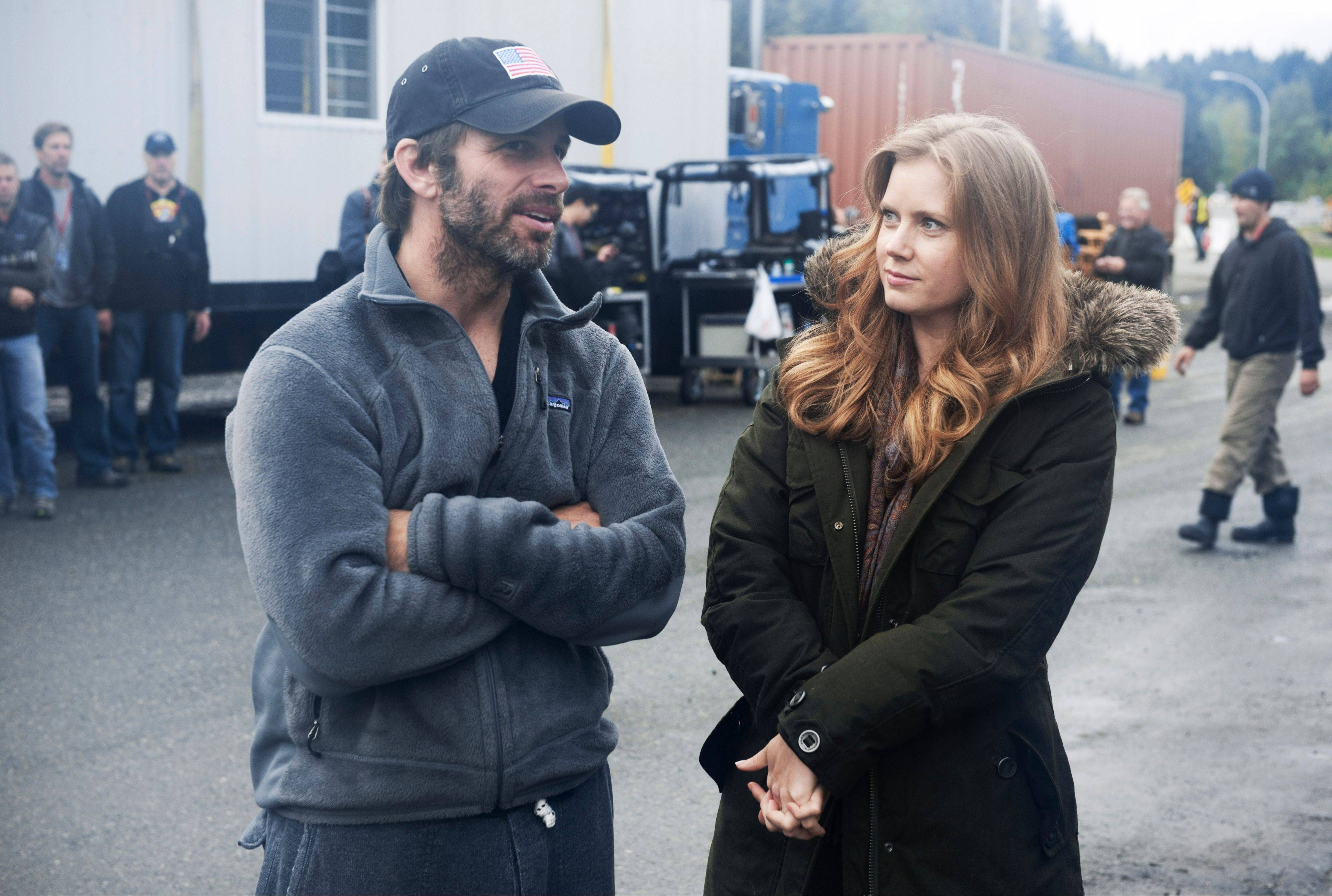 "Director Zack Snyder talks with Lois Lane star Amy Adams on a Plano location for the movie ""Man of Steel."""
