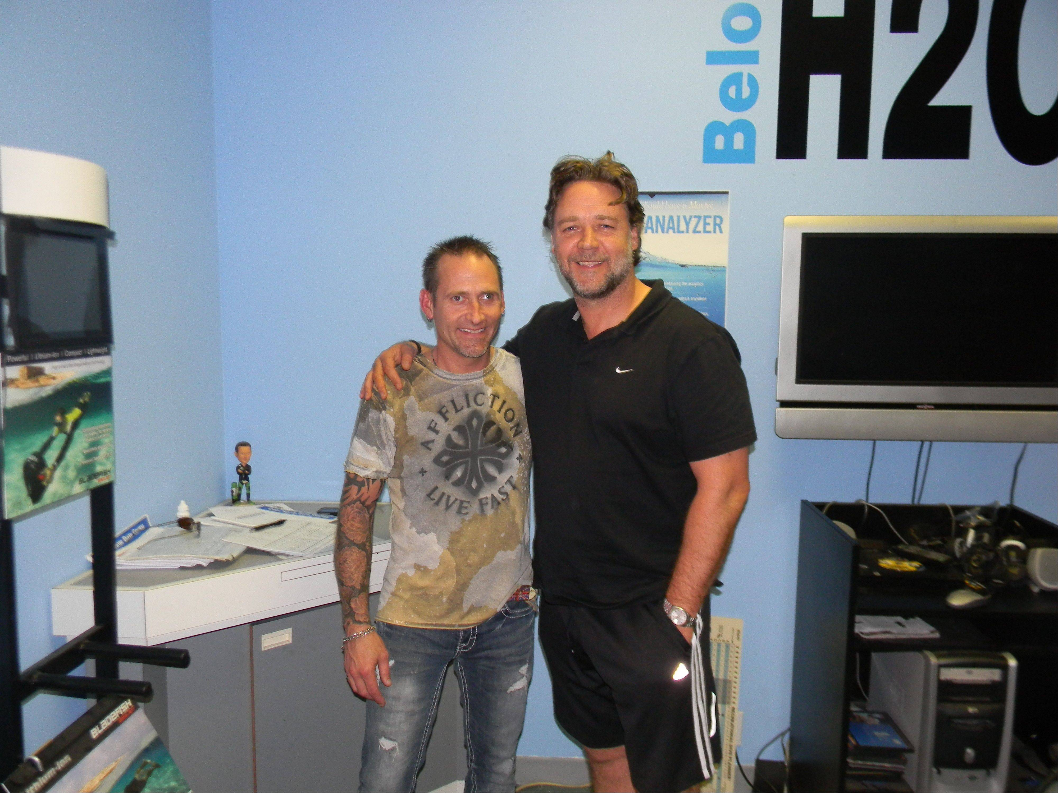 "Aurora resident Dave Rautio of Naperville's Below H20 poses with Russell Crowe, right, during training sessions for the movie ""Man of Steel."""