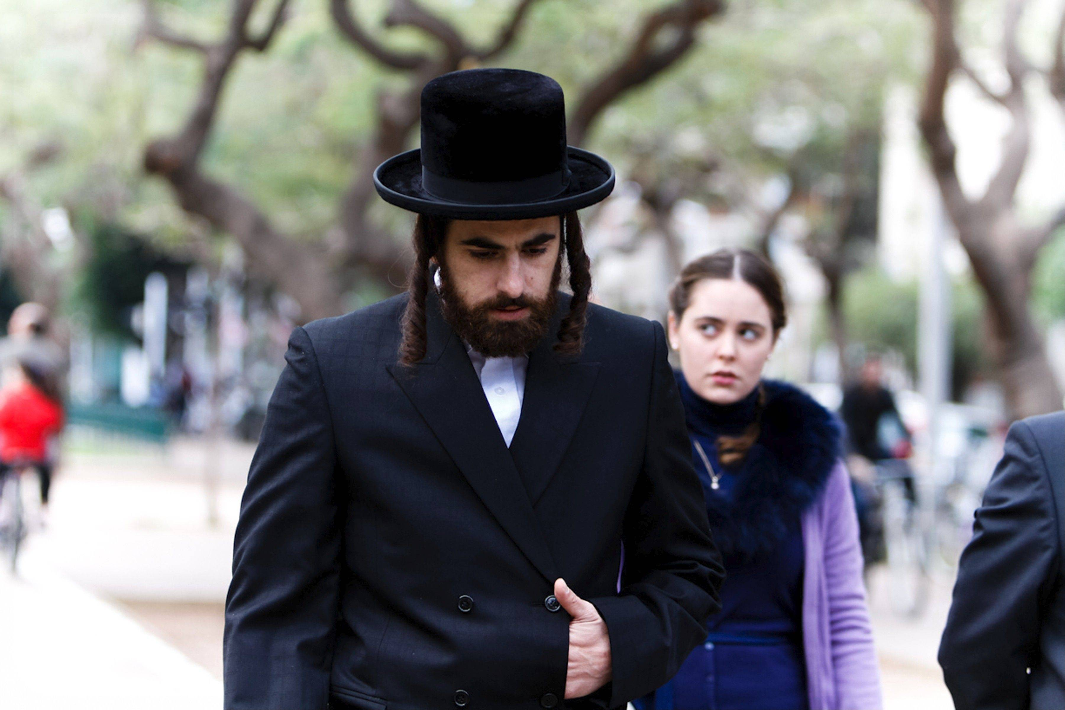 "Yochay (Yiftach Klein) walks with Shira (Hadas Yaron) in Rama Burshtein's drama of family conflict ""Fill the Void."""