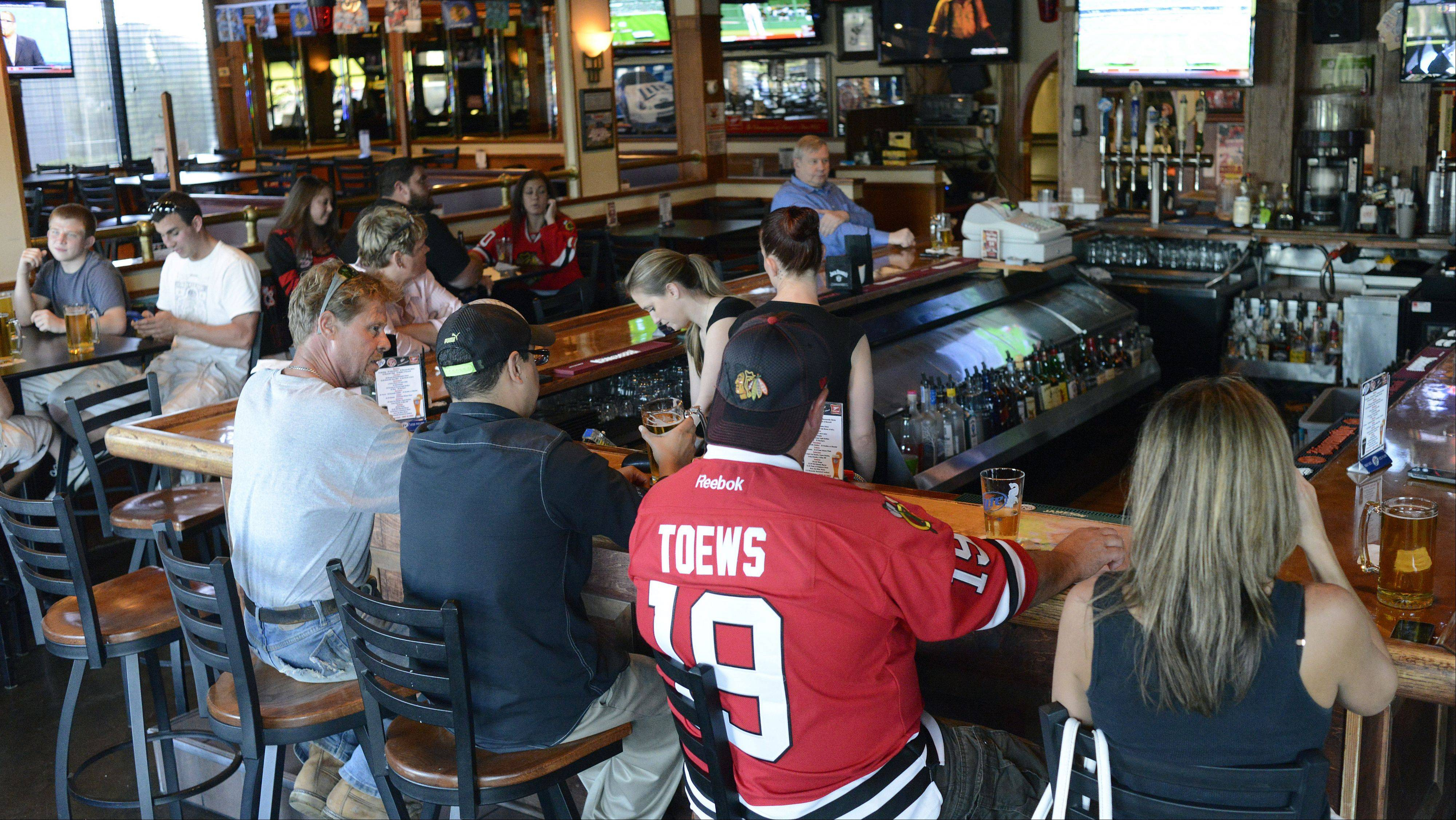 Regular customer Scott Kennedy of Aurora wears his Jonathan Toews jersey at Chelios' Pub in Aurora.