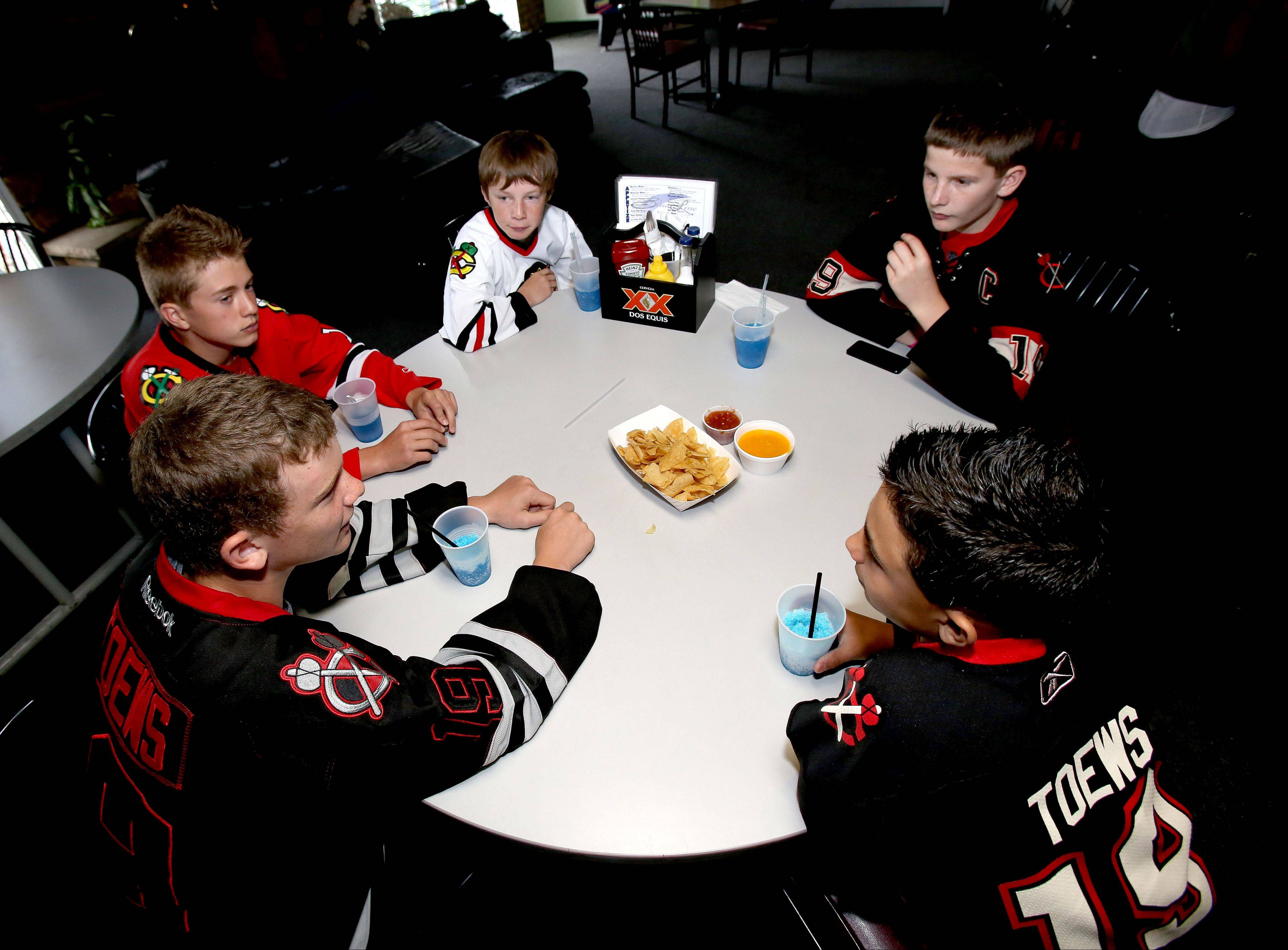 Young Chicago Blackhawks fans Nick DiBenardo, Nick D'Ambrose, Simon Marinelli, Michael Krefft and Jack Muccianti, all 13 and from Addison, hang out at the Blue Line Bar & Grill in Addison.