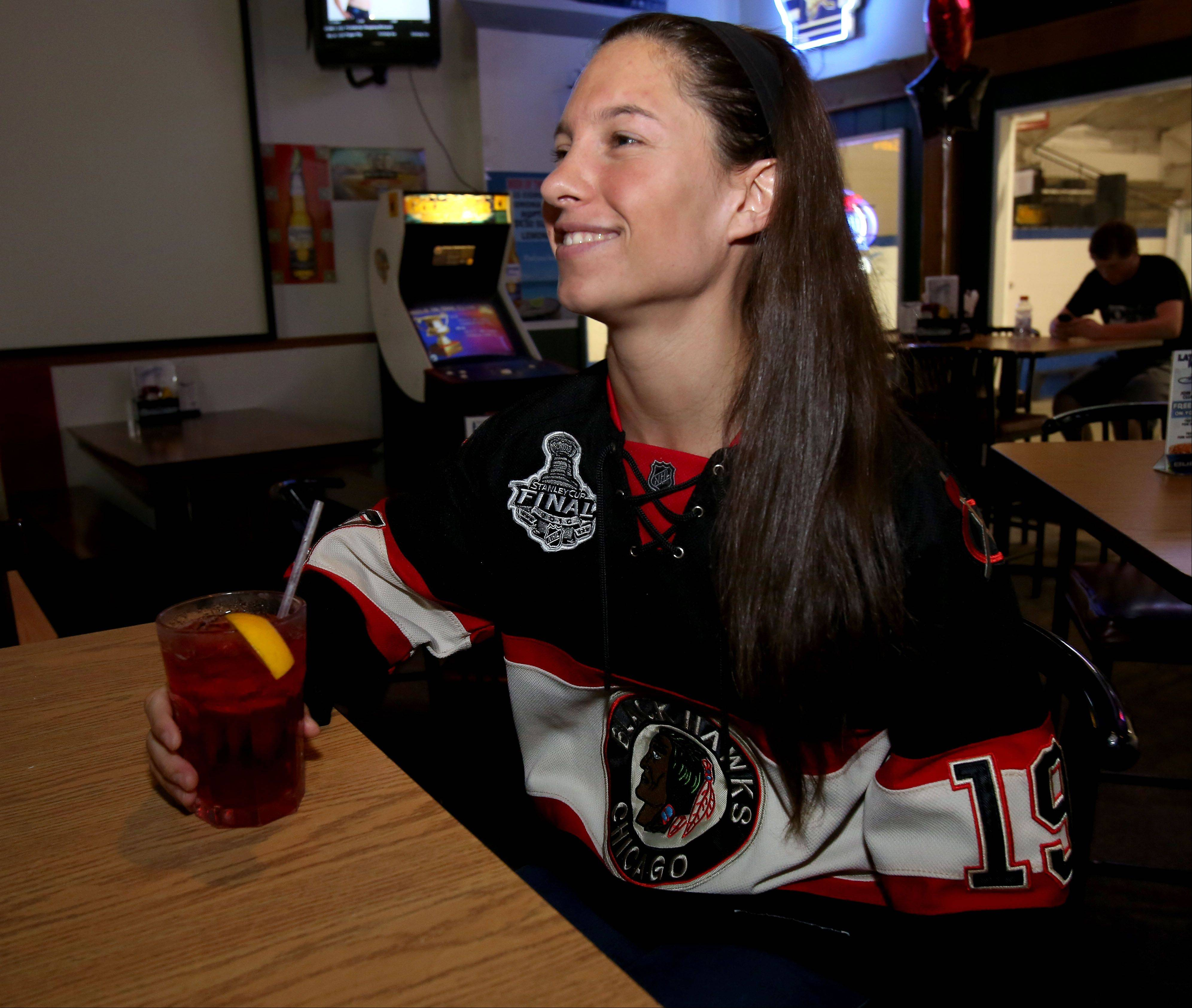 Amanda Muruato shows off her team spirit at Blue Line Bar & Grill in Addison.
