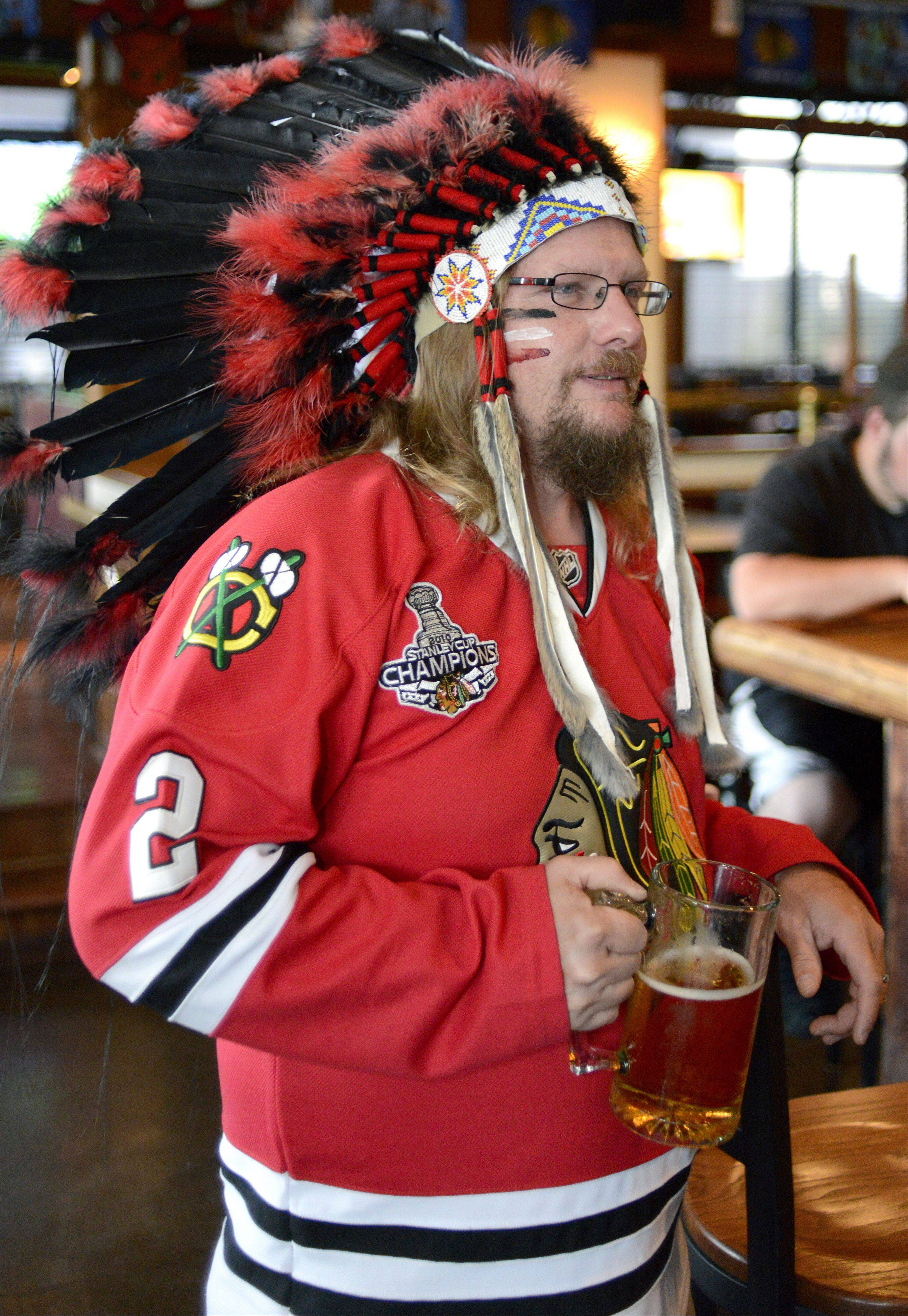 Andy Haas of Oswego is a regular at Chelios' Pub & Grill in Aurora. He's been a Blackhawks fan for about 20 years. He started wearing the headdress to the bar when the team went to the finals.