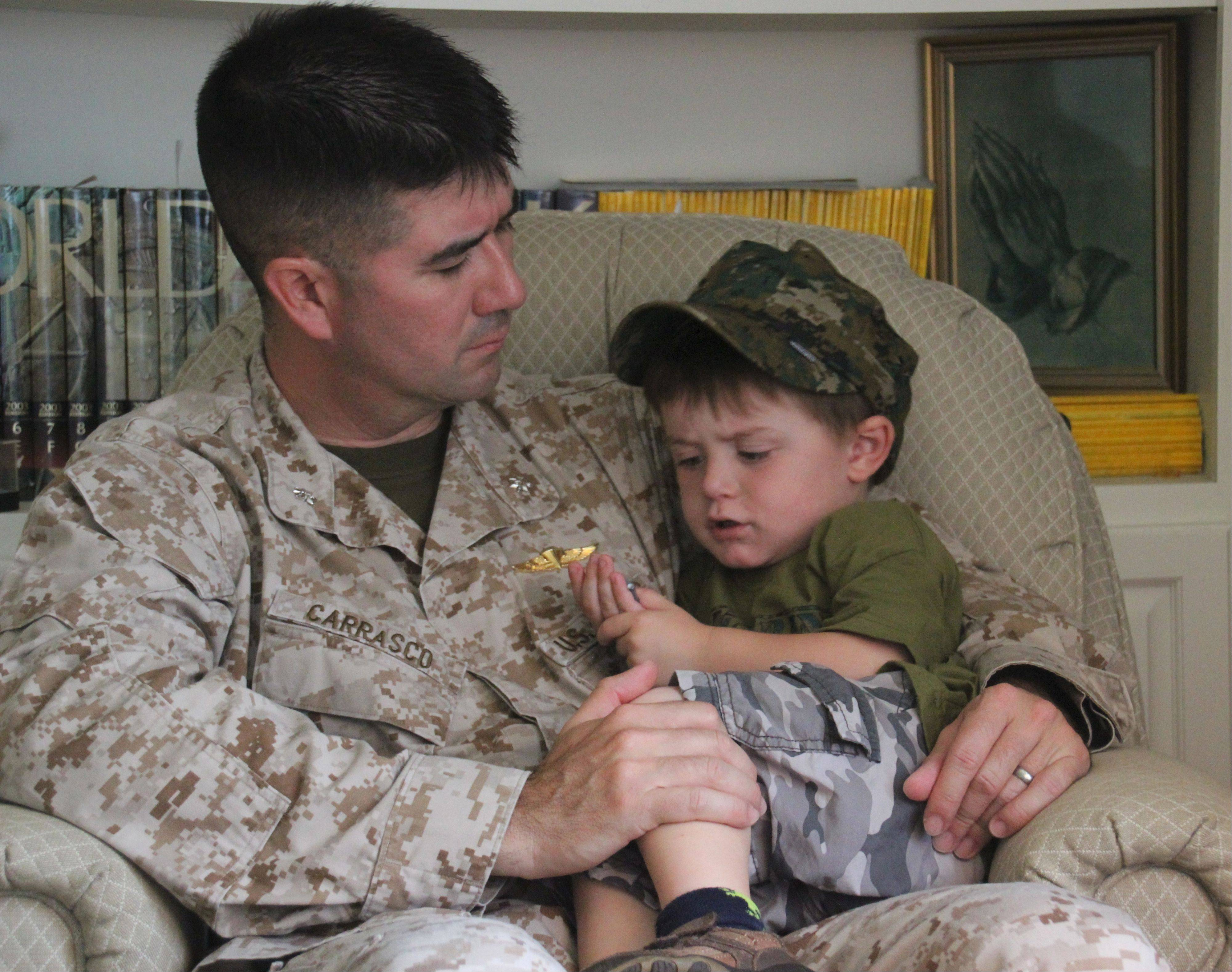 Four days before departing for dangerous military duty at an undisclosed location in the Middle East, Marine Lt. Col. Samuel Carrasco spends quality time with his young son, William.
