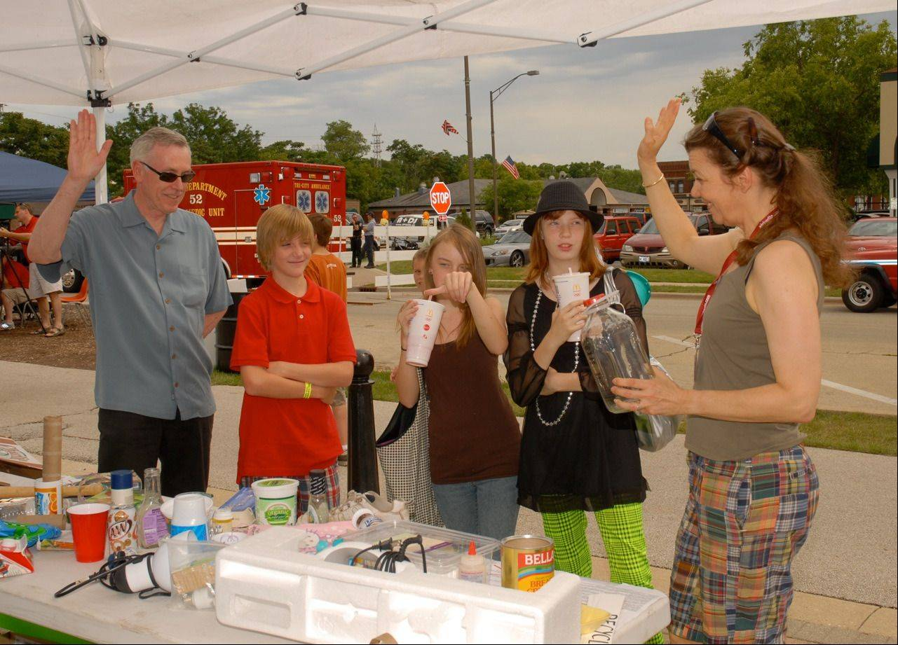 "Visitors to the 2012 Batavia Green Walk play ""The Recycle Game"" with Batavia Environmental Commission member Dianne Peterson, right. This year's Green Walk is Saturday."