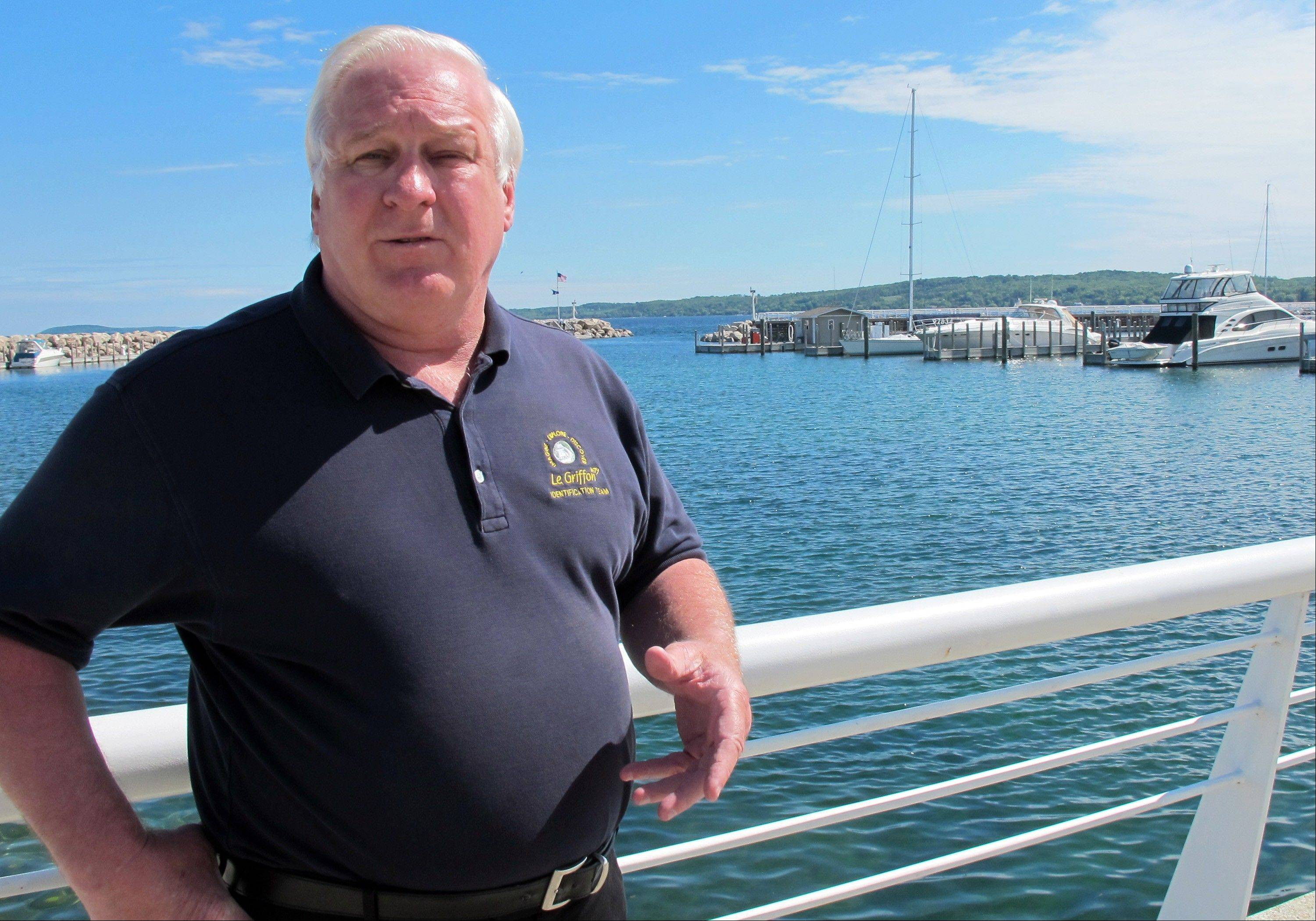 Steve Libert, president of Great Lakes Exploration Group, stands near the Traverse City, Mich., marina on Lake Michigan. On Saturday, Libert will lead a diving expedition to determine whether timbers he found are remains of the legendary Griffin.