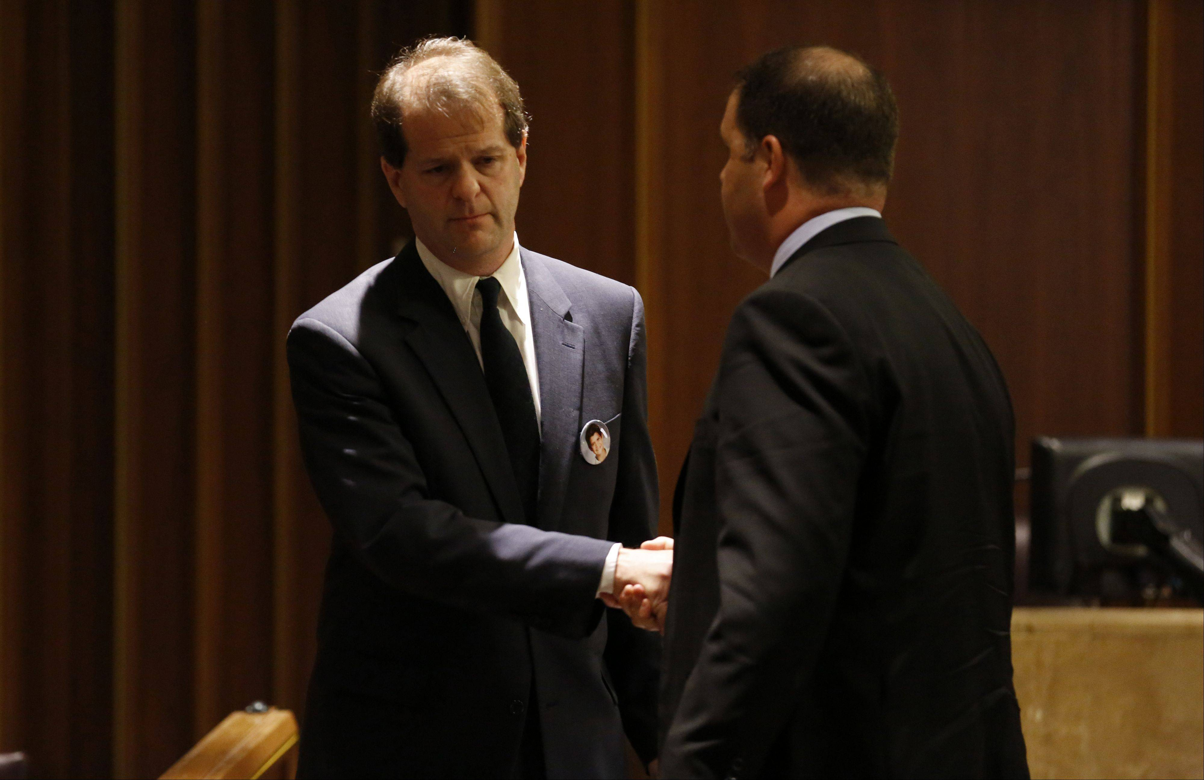 POOL/Chicago Tribune, Stacey WescottJim Borcia, father of Tony Borcia, shakes hands with prosecutor Ari Fisz following Borcia's emotional victim impact statement Thursday at the sentencing hearing for David Hatyina. The Bartlett man pleaded guilty to a drug and alcohol charge in the boating crash that killed the 10-year-old boy last summer.