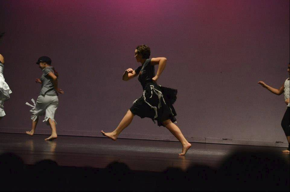 "Chelsie Coren, center, performs a piece called ""Fio Fio Fioletta"" at an Orchesis recital. She's been dancing since she was 3 and choreographed pieces, one of which was chosen for Wheeling High School's appearance in a state festival two years ago."