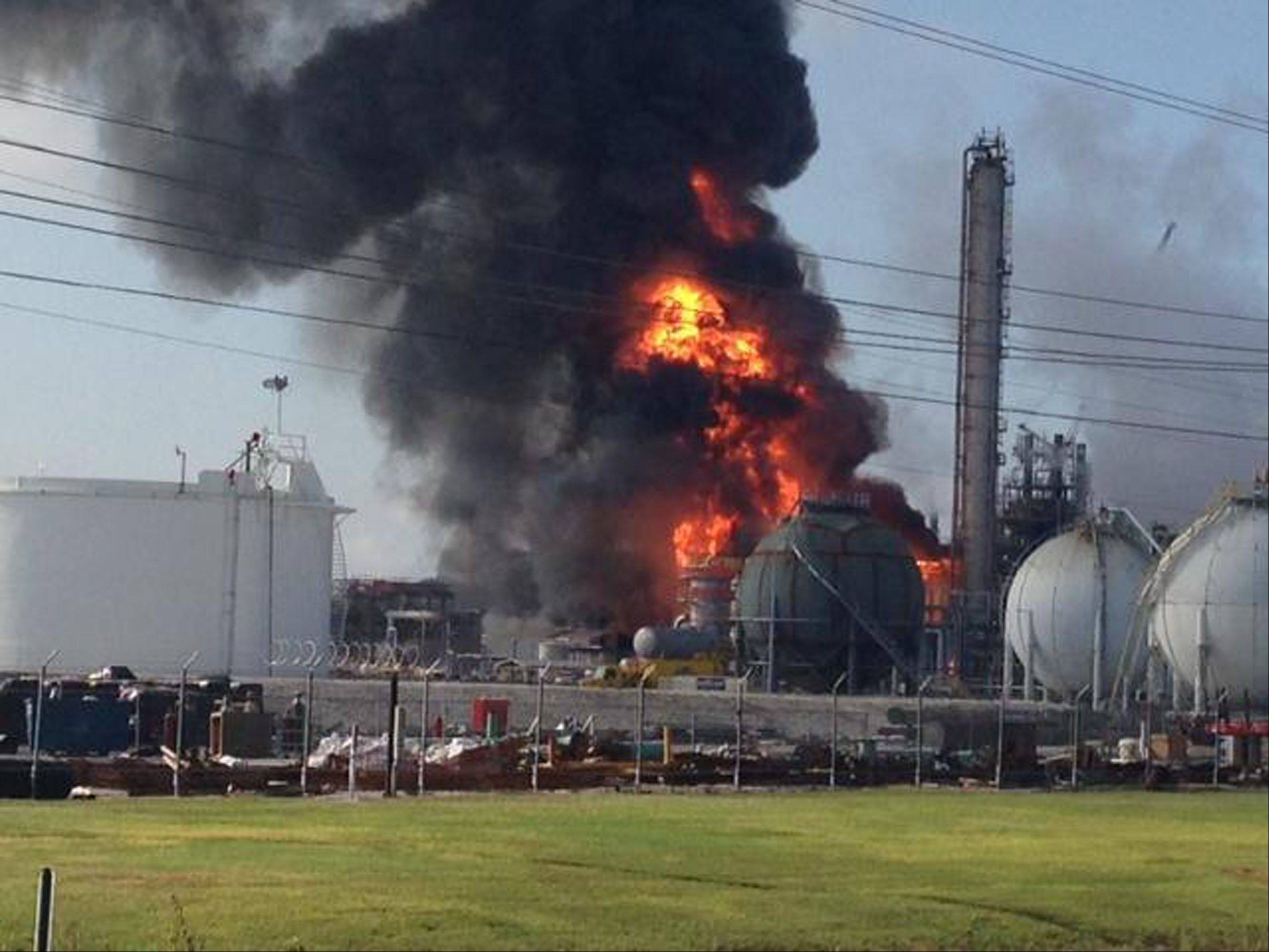 This photo provided by Ryan Meador shows an explosion at The Williams Companies Inc. plant in the Ascension Parish town of Geismar La., Thursday, June 13, 2013. The fire broke out Thursday morning at the plant, which the company's website says puts out about 1.3 billion pounds of ethylene and 90 million pounds of polymer grade propylene a year.