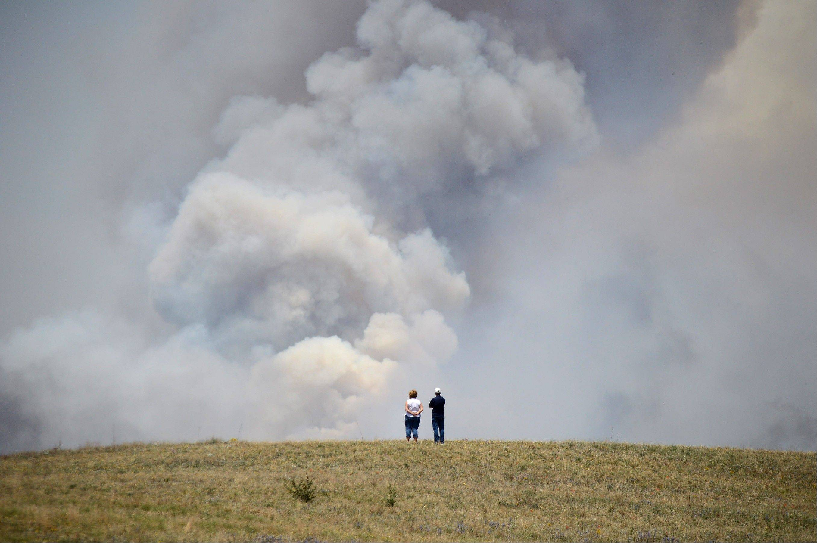Chris and Christine Walker watch the Black Forest Fire gain steam as it burns out of control for a second straight day near Colorado Springs, Colo. on Wednesday, June 12, 2013. The Walkers live nearby and were under pre-evacuation orders.