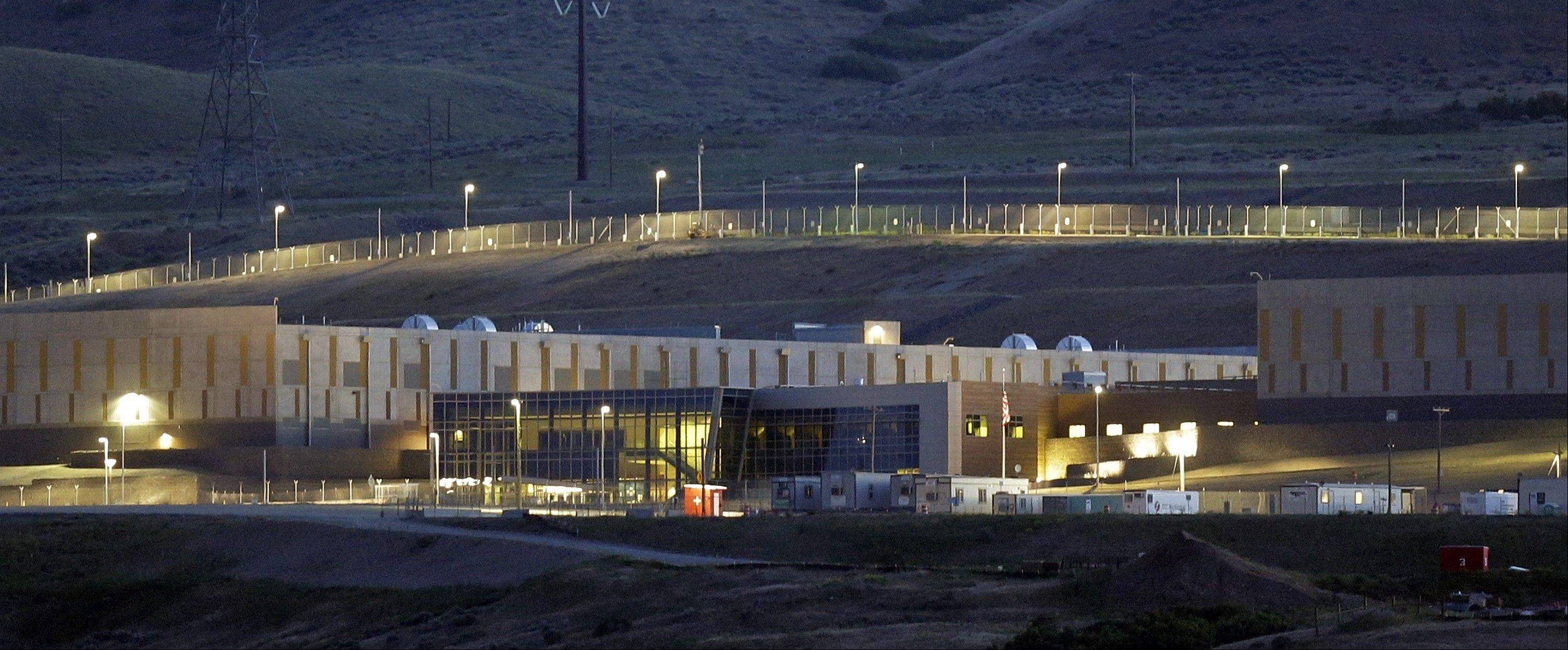 A ground level view of Utah's NSA Data Center in Bluffdale, Utah. The long, squat buildings span 1.5 million square feet, and are filled with superpowered computers designed to store massive amounts of information gathered secretly from phone calls and emails.