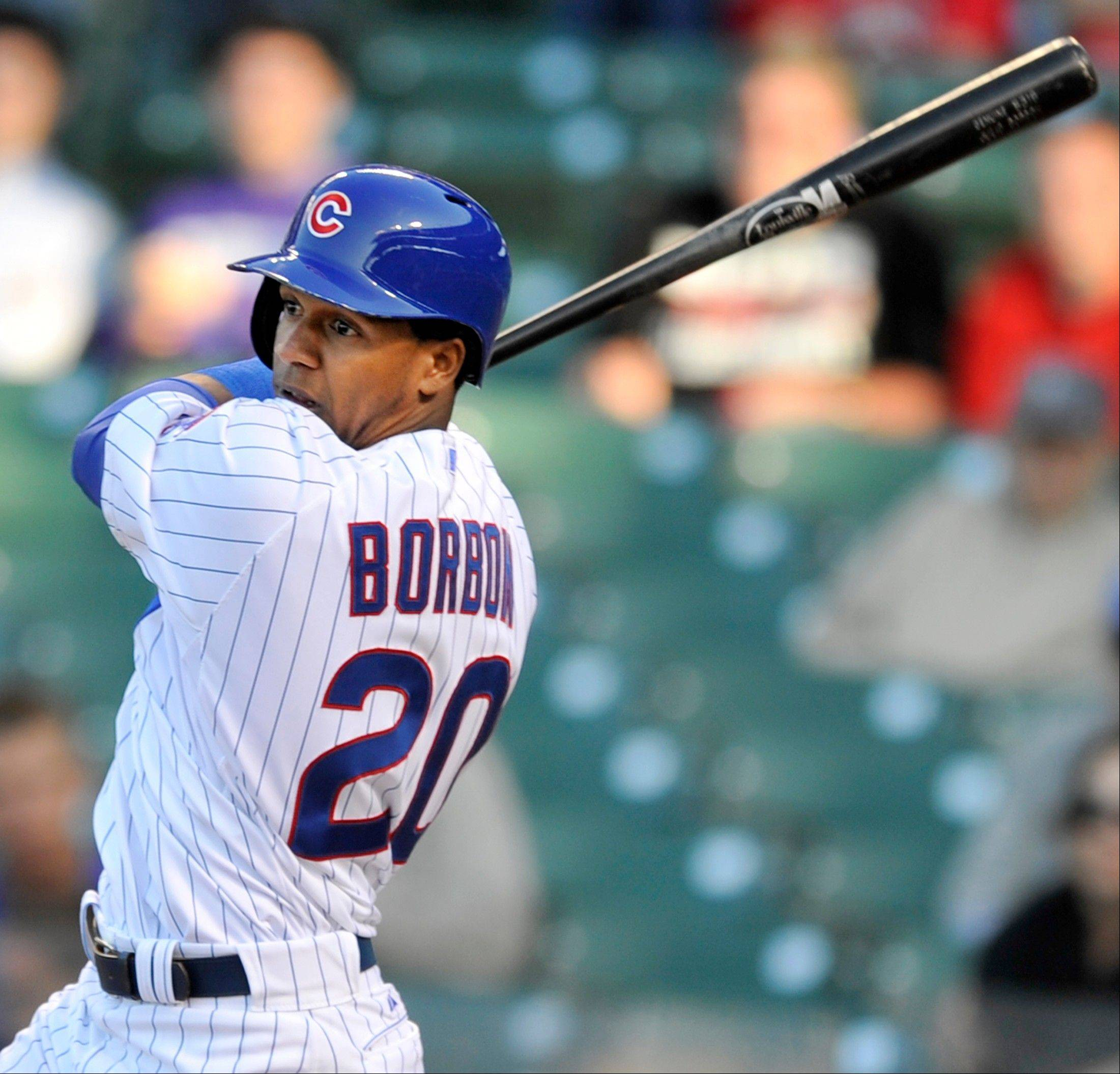 Chicago Cubs' Julio Borbon watches his walkoff-single to defeat the Cincinnati Reds 6-5 in fourteen innings of an MLB baseball game in Chicago, Thursday, June 13, 2013.
