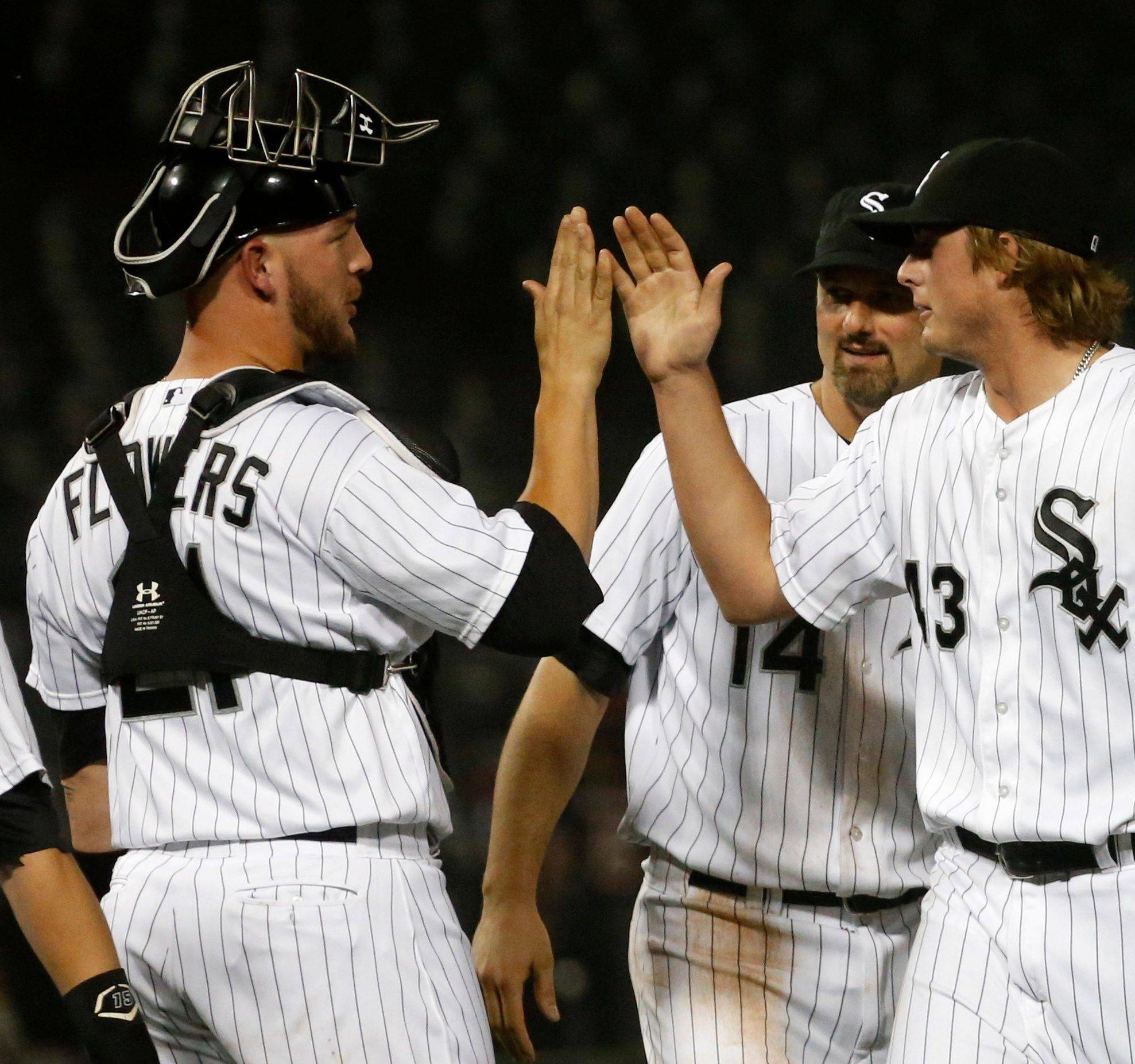 White Sox catcher Tyler Flowers celebrates with Addison Reed after the Sox beat Toronto on Monday.