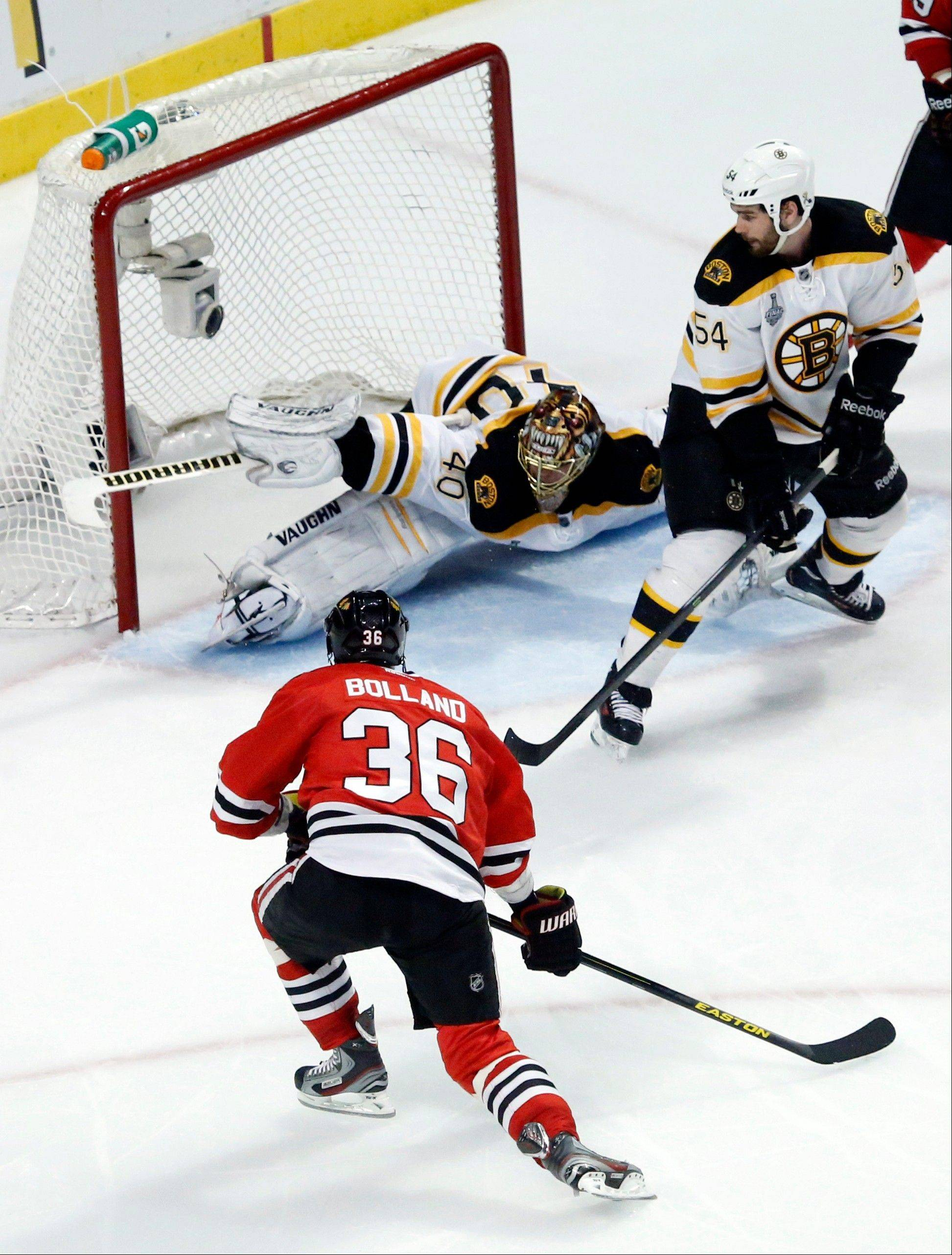 Chicago Blackhawks center Dave Bolland (36) scores a goal against Boston Bruins goalie Tuukka Rask (40) during the third period of Game 1 in their NHL Stanley Cup Final hockey series on Wednesday, June 12, 2013, in Chicago.