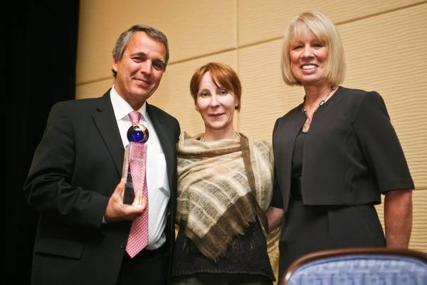 The first Cancer Researcher of the Year Award is presented to Pierre-Yves Dietrich, MD, PhD, by Eveline Mumenthaler of The Gateway for Cancer Research (middle) and patient advocate Kay Kays.