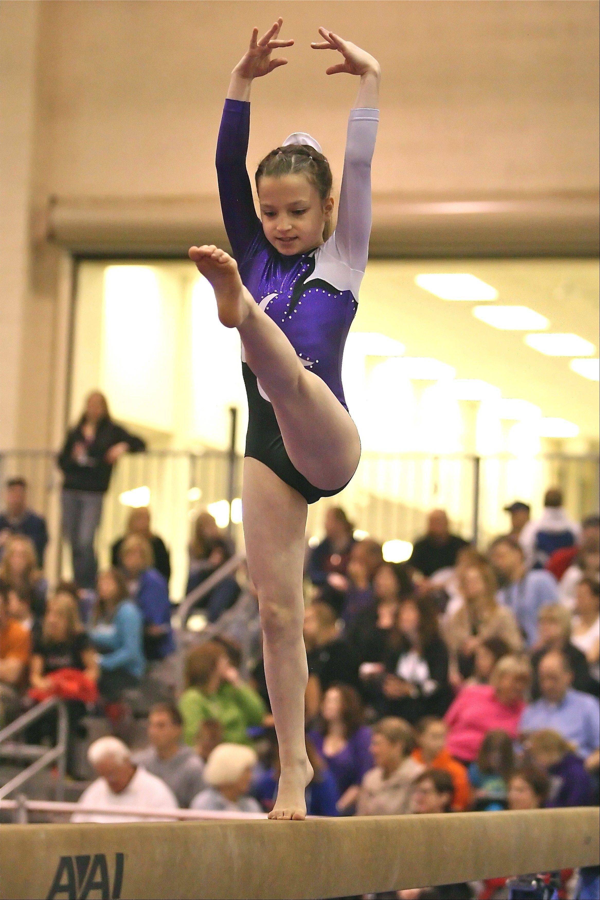Showing perfect poise and balance, Ultimate Gymnastics' Gianna Pasquesi performs her beam routine at the Level 5 State meet. Gianna won silver on the event but took the gold medal on the vault in the Junior B age group. She was one of five girls from the Gurnee-based gym to win State titles at the meet, held recently in Peoria