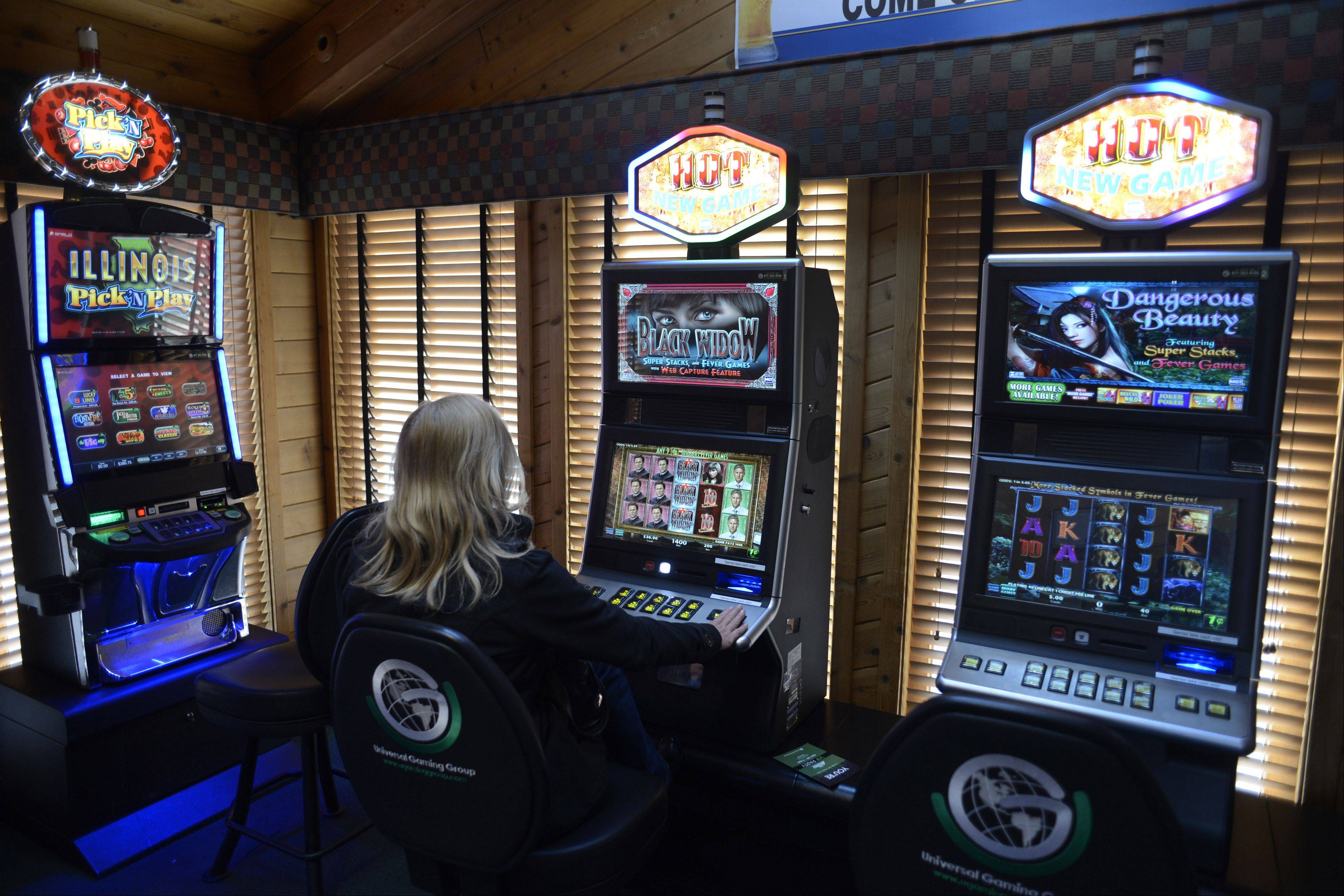 Daily Herald File Photo A patron plays a video gambling machine in Hoffman Estates.