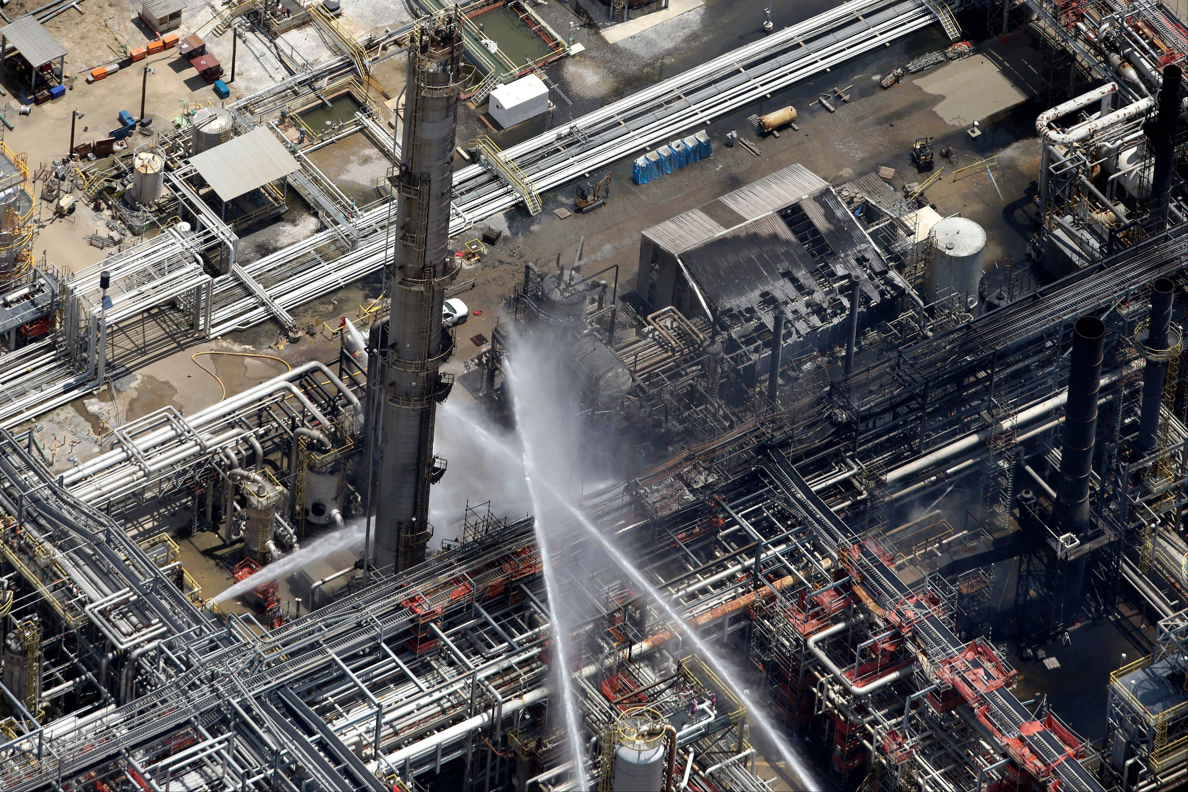 A chemical plant fire is seen in an aerial photo about twenty miles southeast of Baton Rouge, in Geismer, La., Thursday, June 13, 2013. The plant makes highly flammable gases that are basic building blocks in the petrochemical industry.