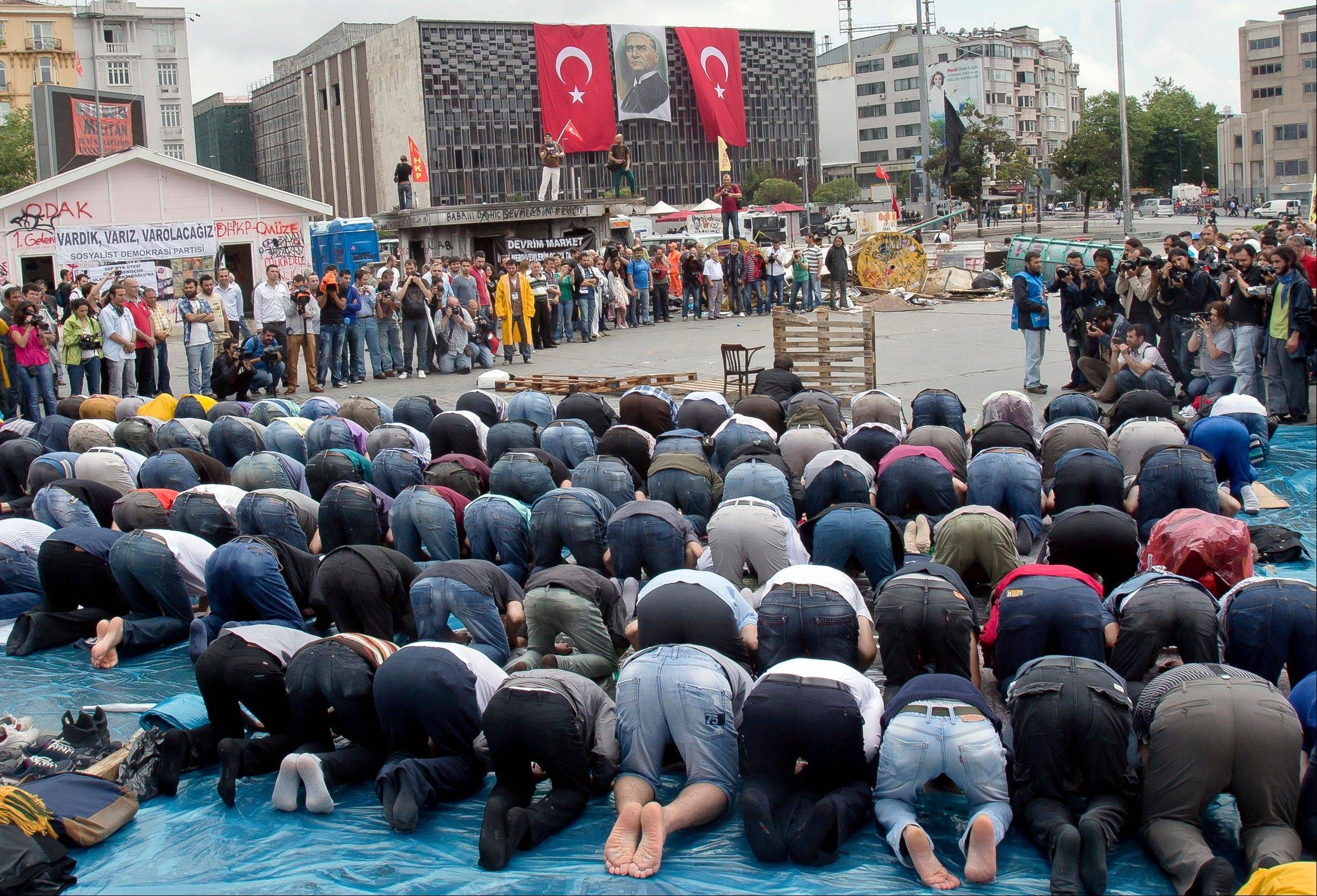 Protesters attend prayers in Taksim Square, Friday.