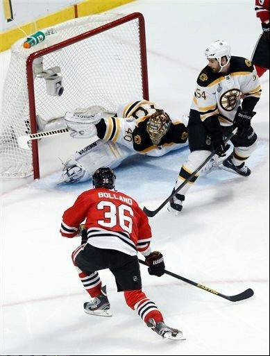 Chicago Blackhawks center Dave Bolland (36) scores a goal against Boston Bruins goalie Tuukka Rask (40) during the third period of Game 1 in their NHL Stanley Cup Final hockey series on Wednesday, June 12, 2013, in Chicago. (AP Photo/Charles Rex Arbogast)