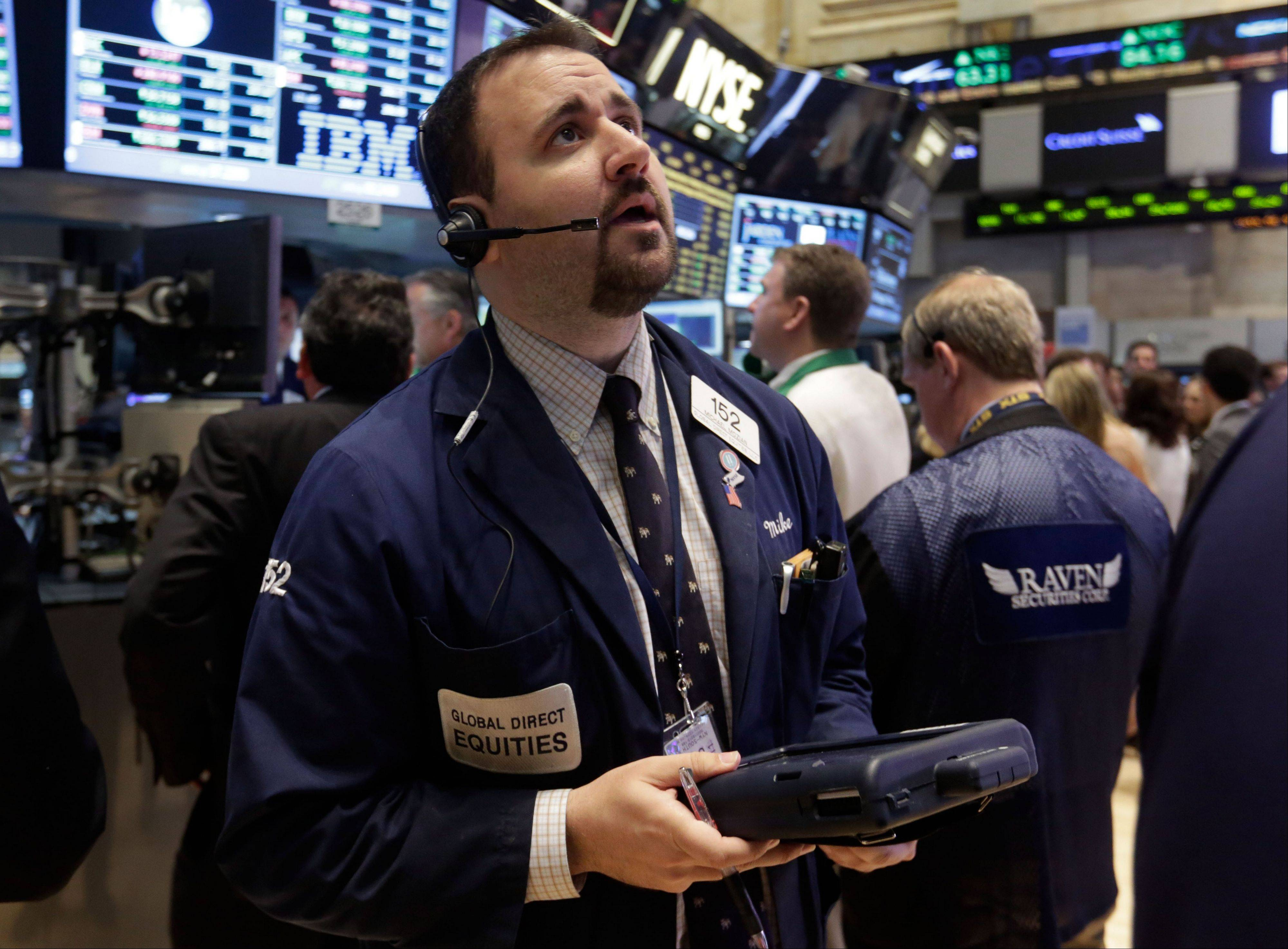 Trader Michael Mozian works Monday on the floor of the New York Stock Exchange.
