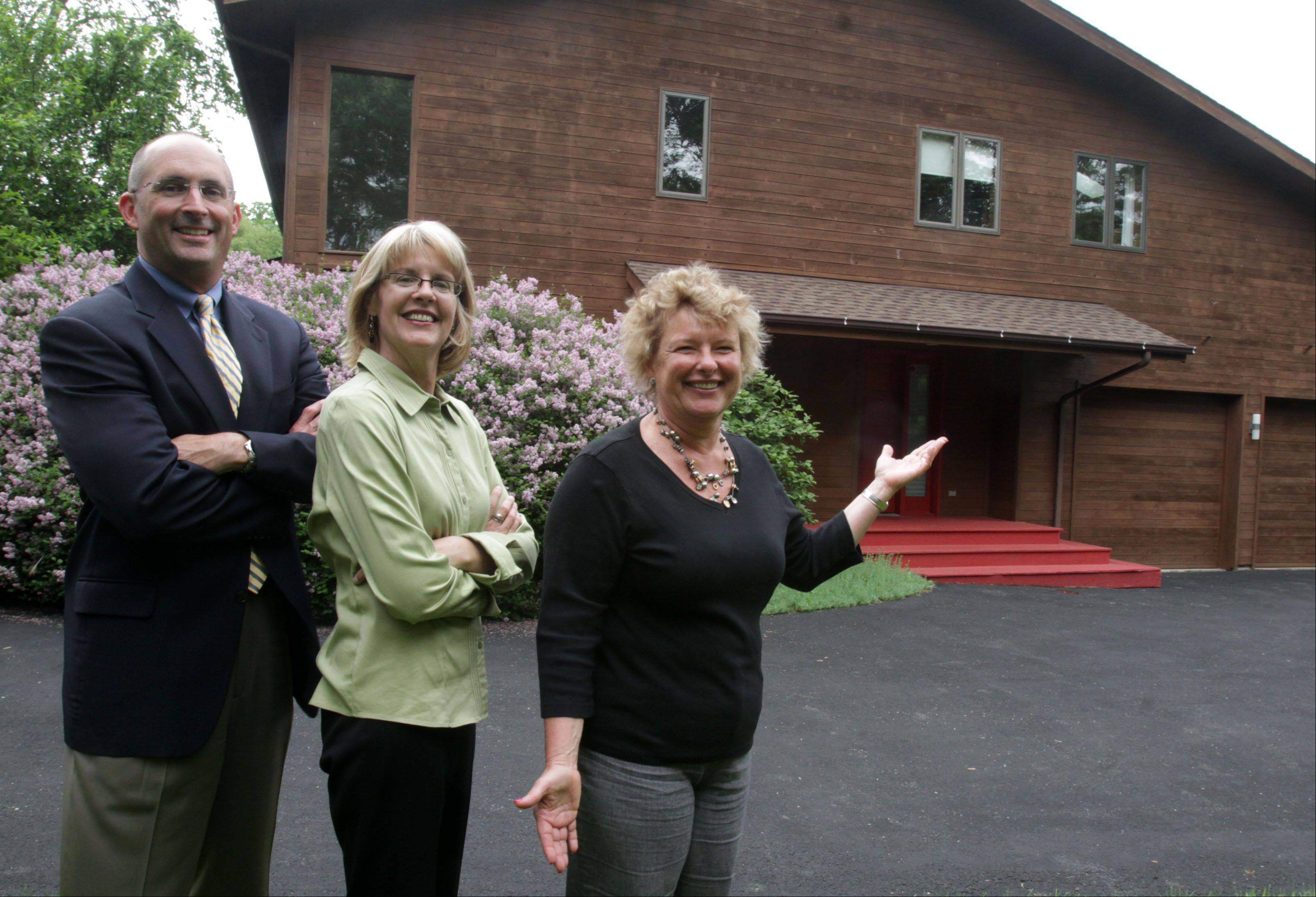 George LeClaire/gleclaire@dailyherald.com � Realtor Mark Munro, left to right, Mary Loughman, the stager, and former homeowner Irisa Putnins outside of Putnins former home in Deer Park that they improved and sold in one day last year. Here on May 31, 2013.