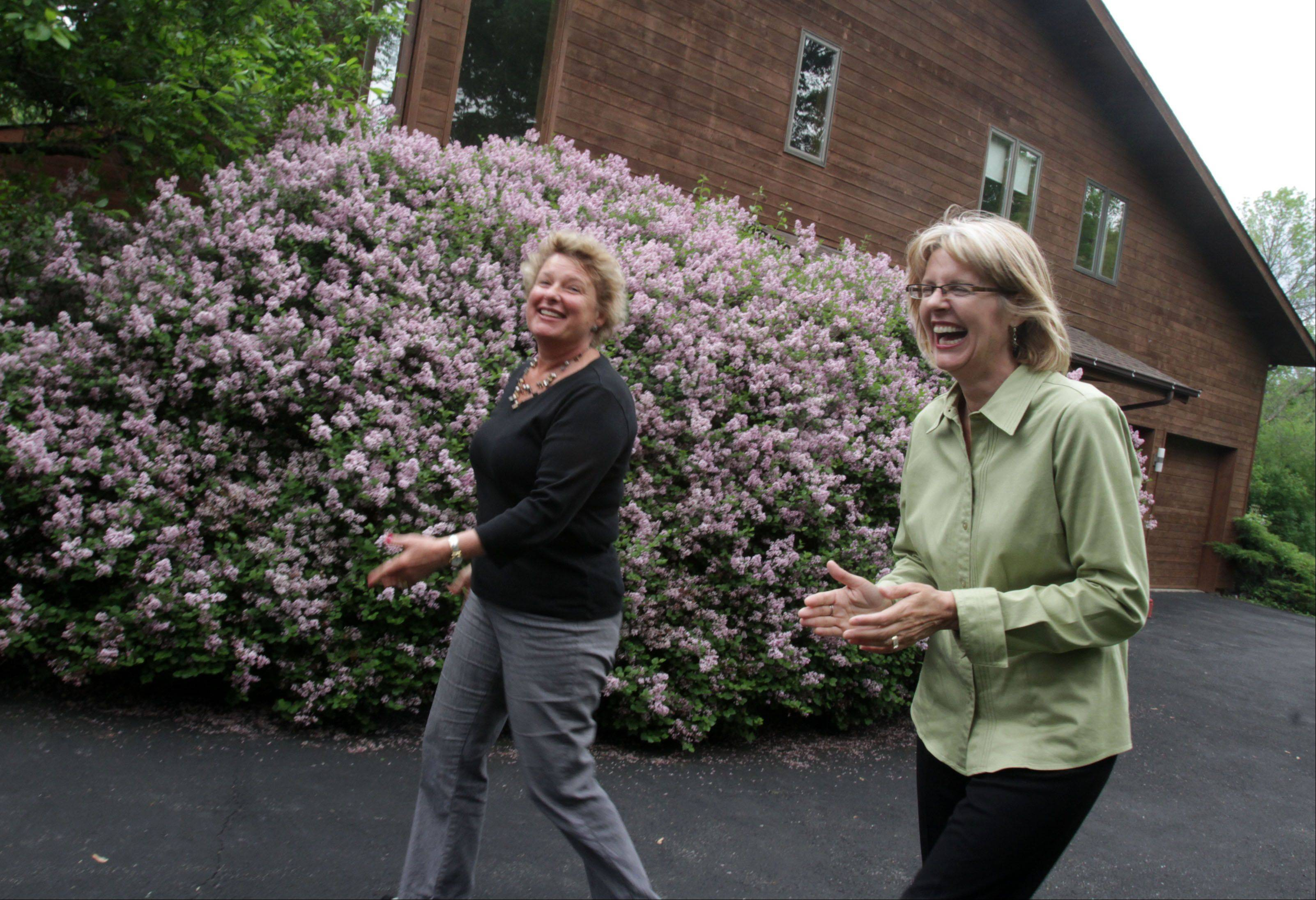 George LeClaire/gleclaire@dailyherald.com � Former homeowner Irisa Putnins, left, and Mary Loughman, the stager, enjoy a moment outside of Putnins former home in Deer Park that they improved and sold in one day last year. Here on May 31, 2013.