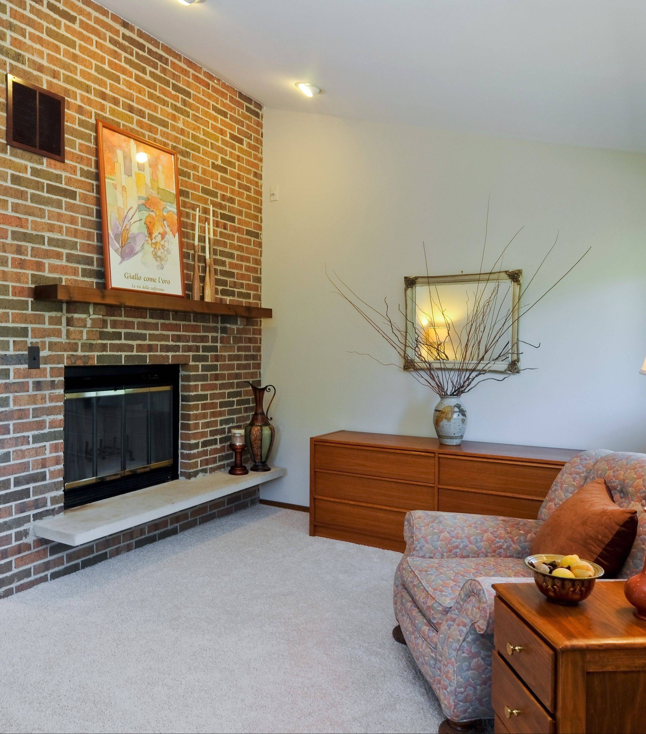 The fireplace area in the master bedroom was depersonalized and decluttered so any of the perspective buyers could picture their lives in this house.