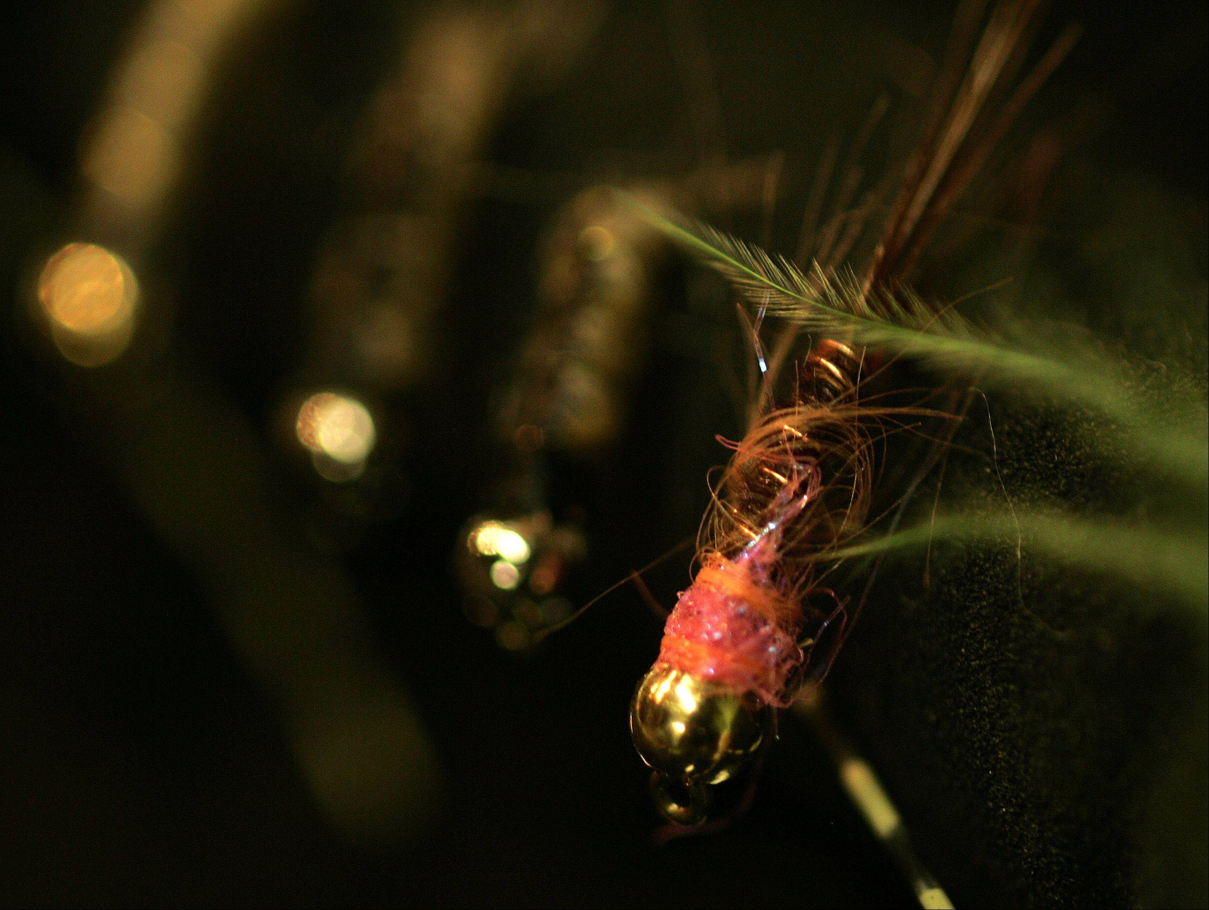 A bait called a pink squirrel sits in one of Domagalski's fly boxes. The fly is well-known to fly fishermen in southwestern Wisconsin.