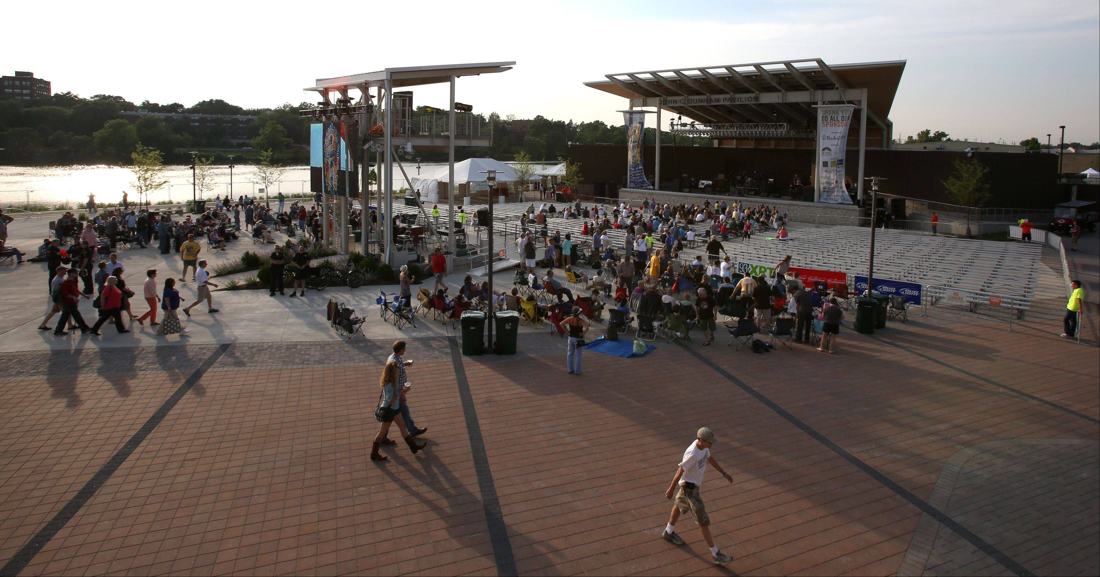 The crowd trickles in during the opening night of RiverEdge Park, coinciding with the 17th annual Blues on the Fox festival.