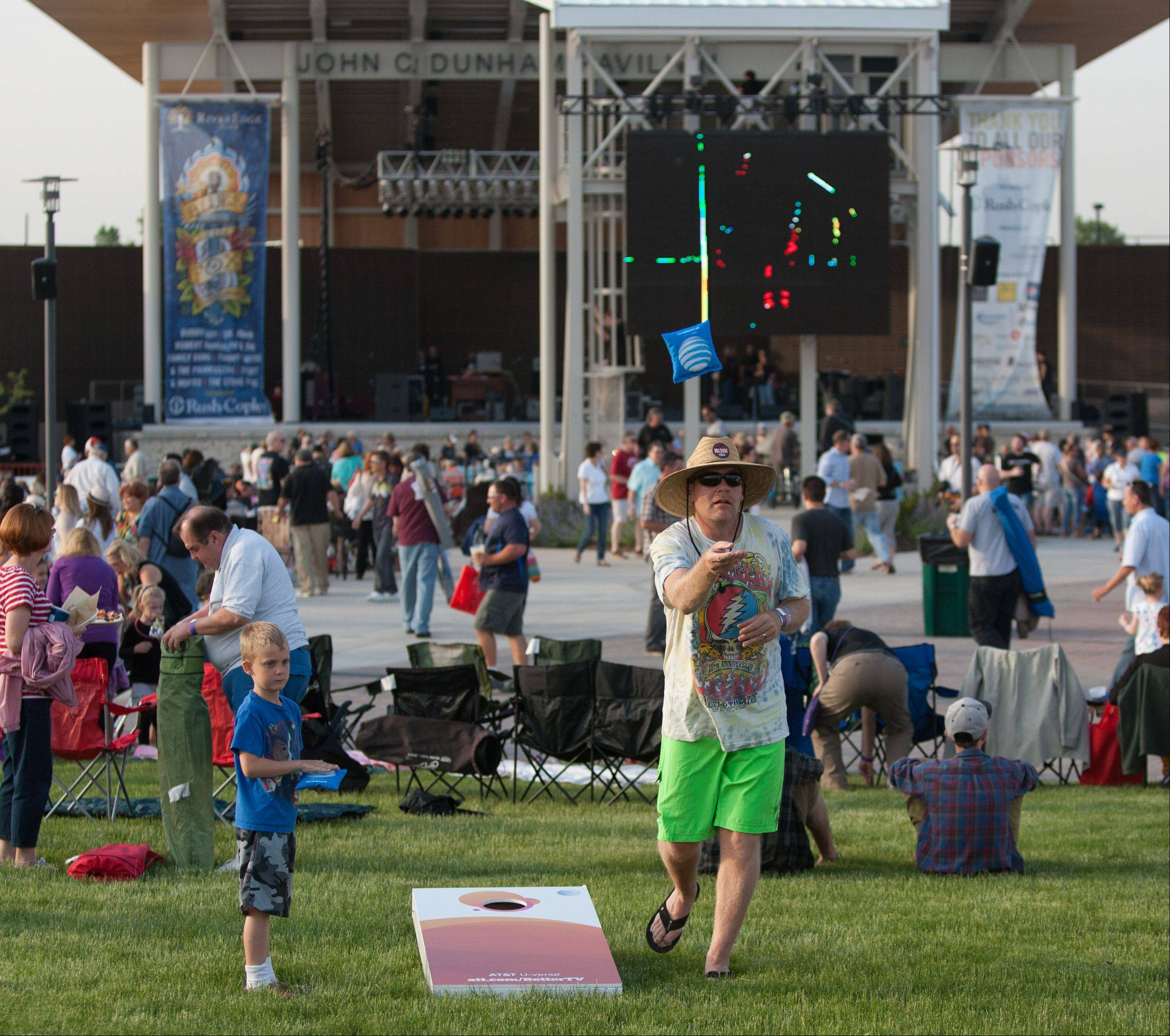 Brian Voss of Darien plays bags, during the opening night of RiverEdge Park, coinciding with the 17th annual Blues on the Fox festival. At left is his son Evan.