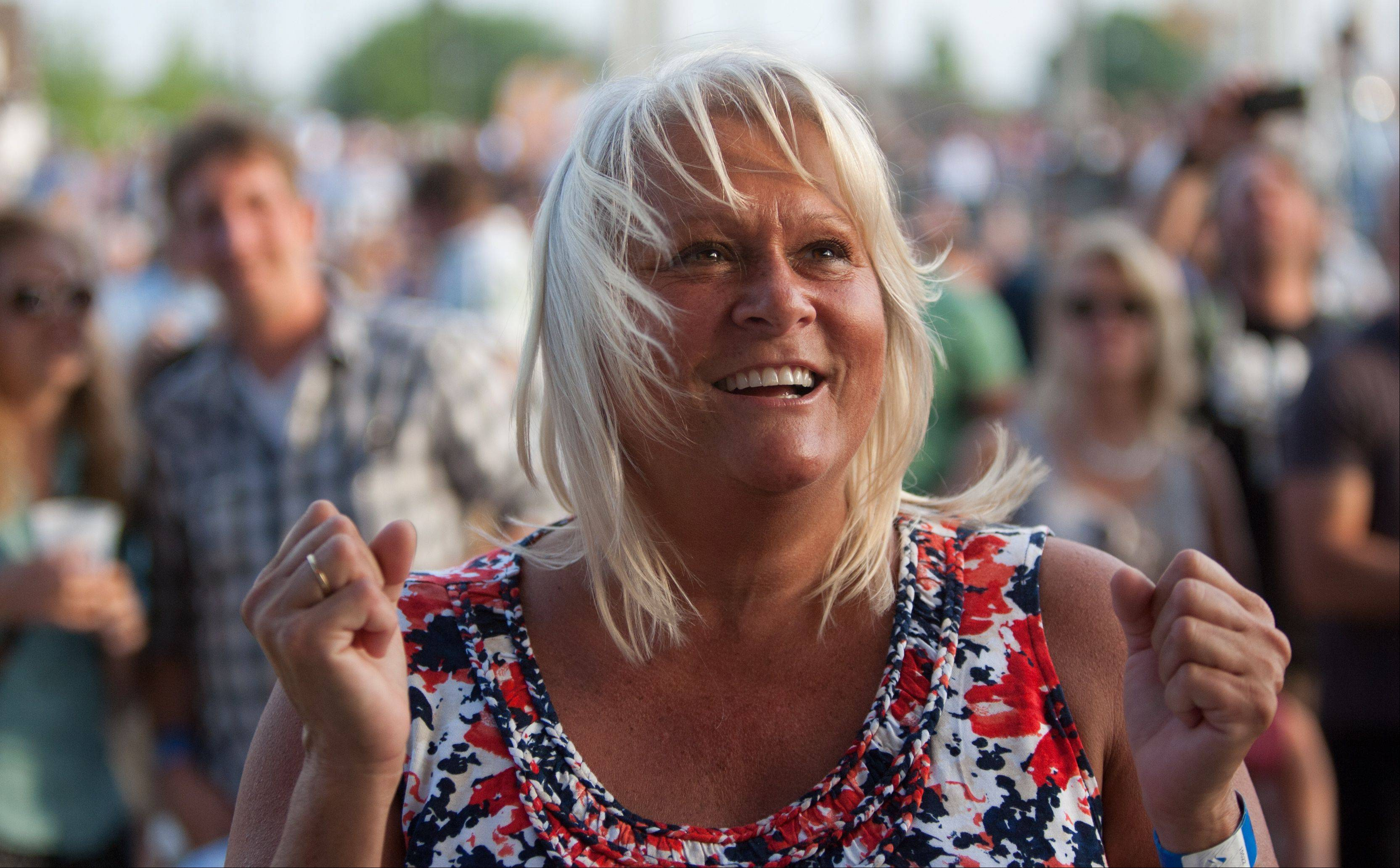 Nicki Rozmarnowski cheers on opening act JJ Grey & Mofro, during the opening night of RiverEdge Park, coinciding with the 17th annual Blues on the Fox festival.