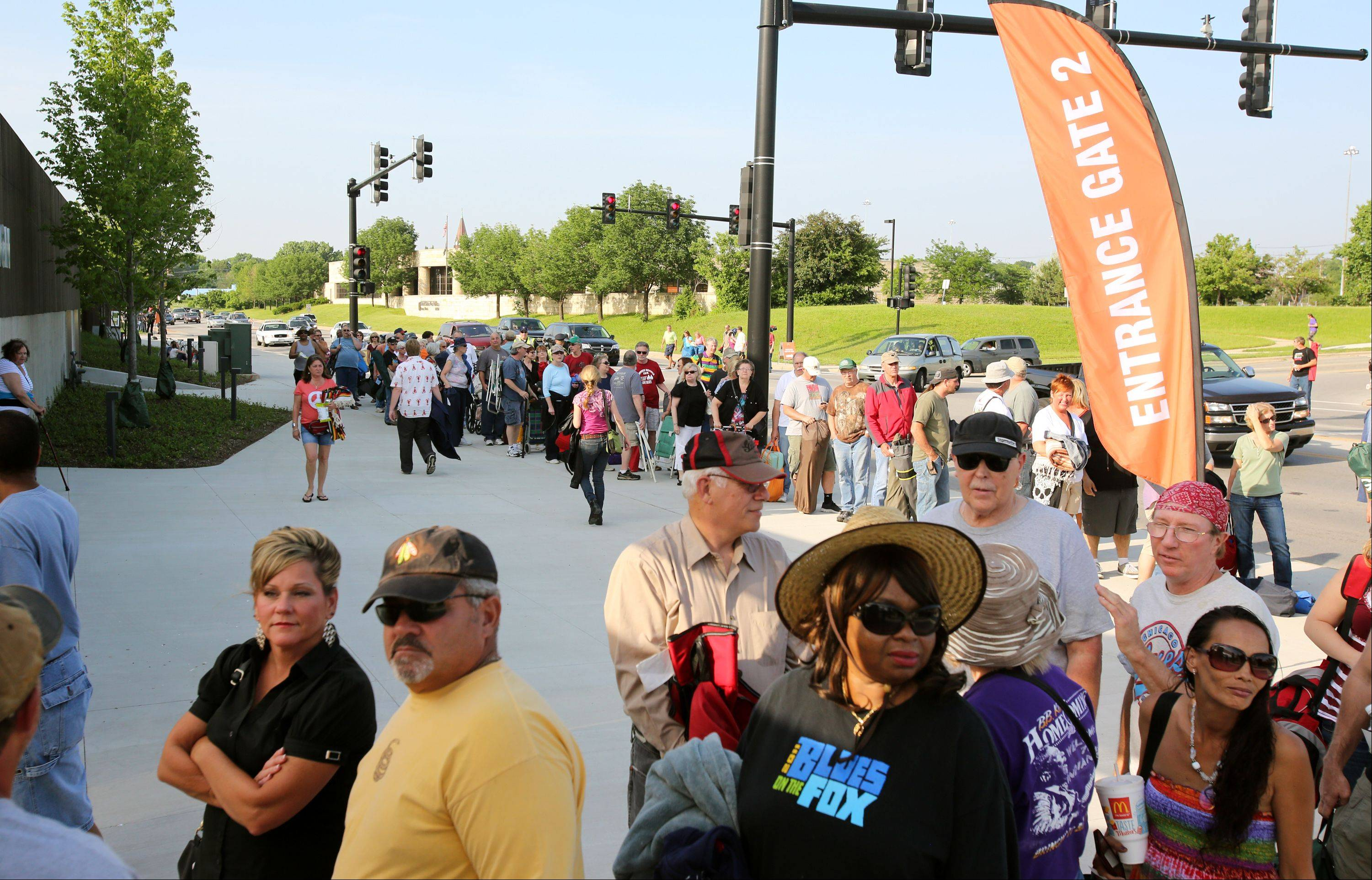 Lines form for the opening night of RiverEdge Park, coinciding with the 17th annual Blues on the Fox festival.