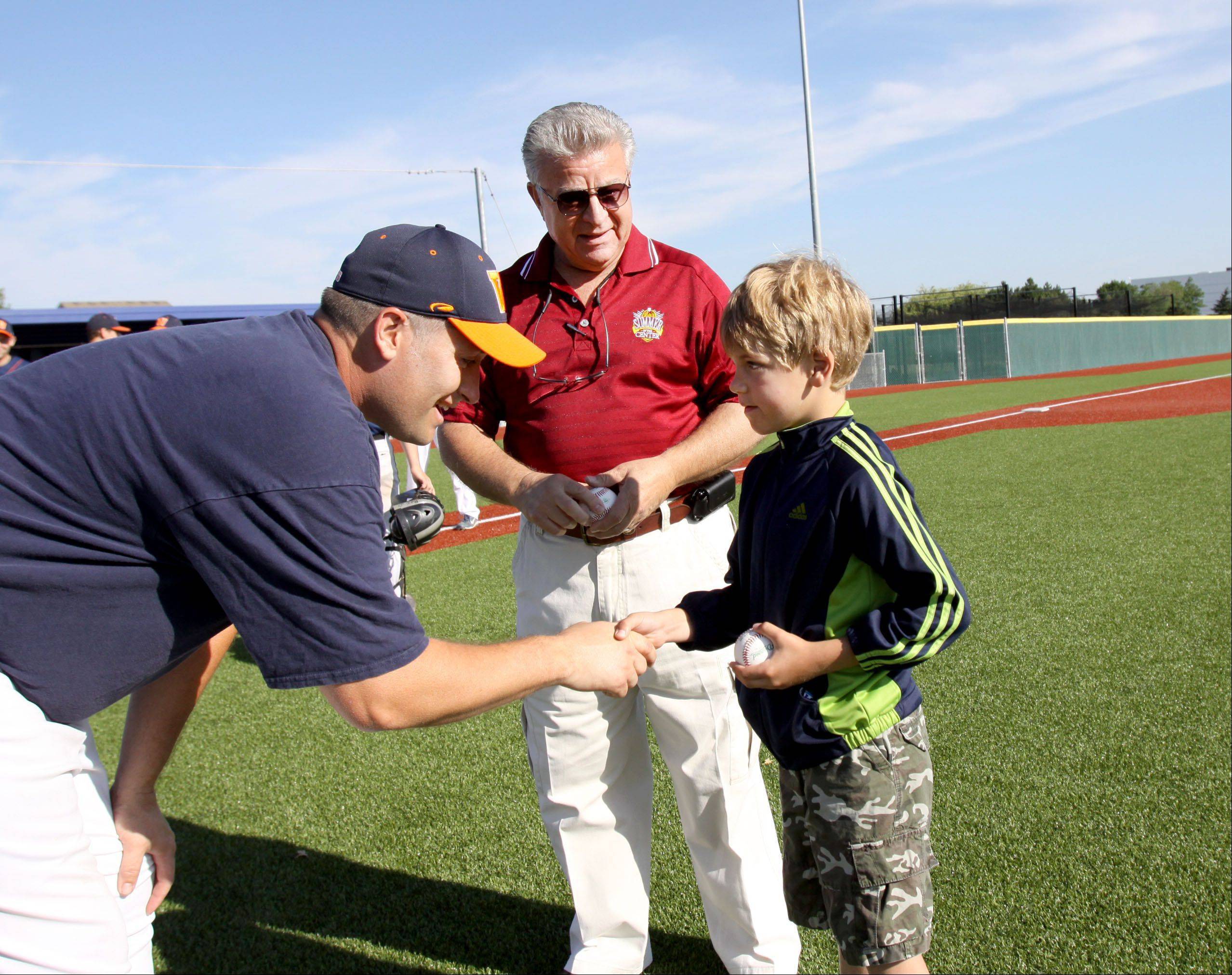 Carol Stream Village President Frank Saverino and his 7-year-old grandson, Dominic, talk with American Legion Post 76 baseball team head coach Jerry Miller Friday after throwing out ceremonial first pitches at the opening of the post's Summer Classic Tournament.