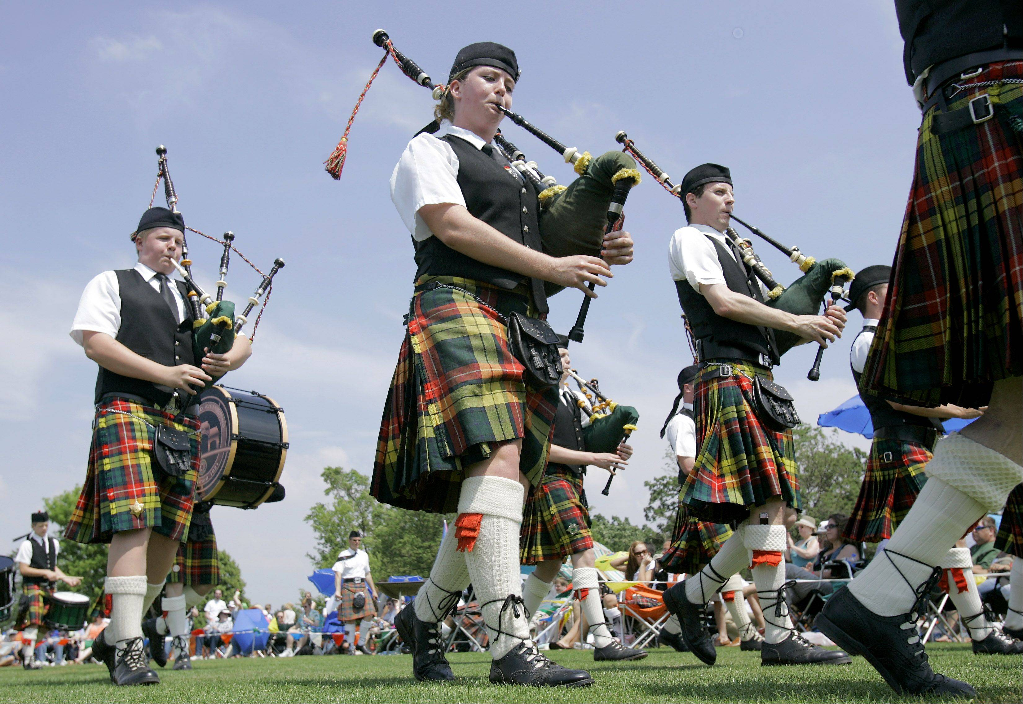 A bagpipe band plans at the Highland Games and Scottish Festival.
