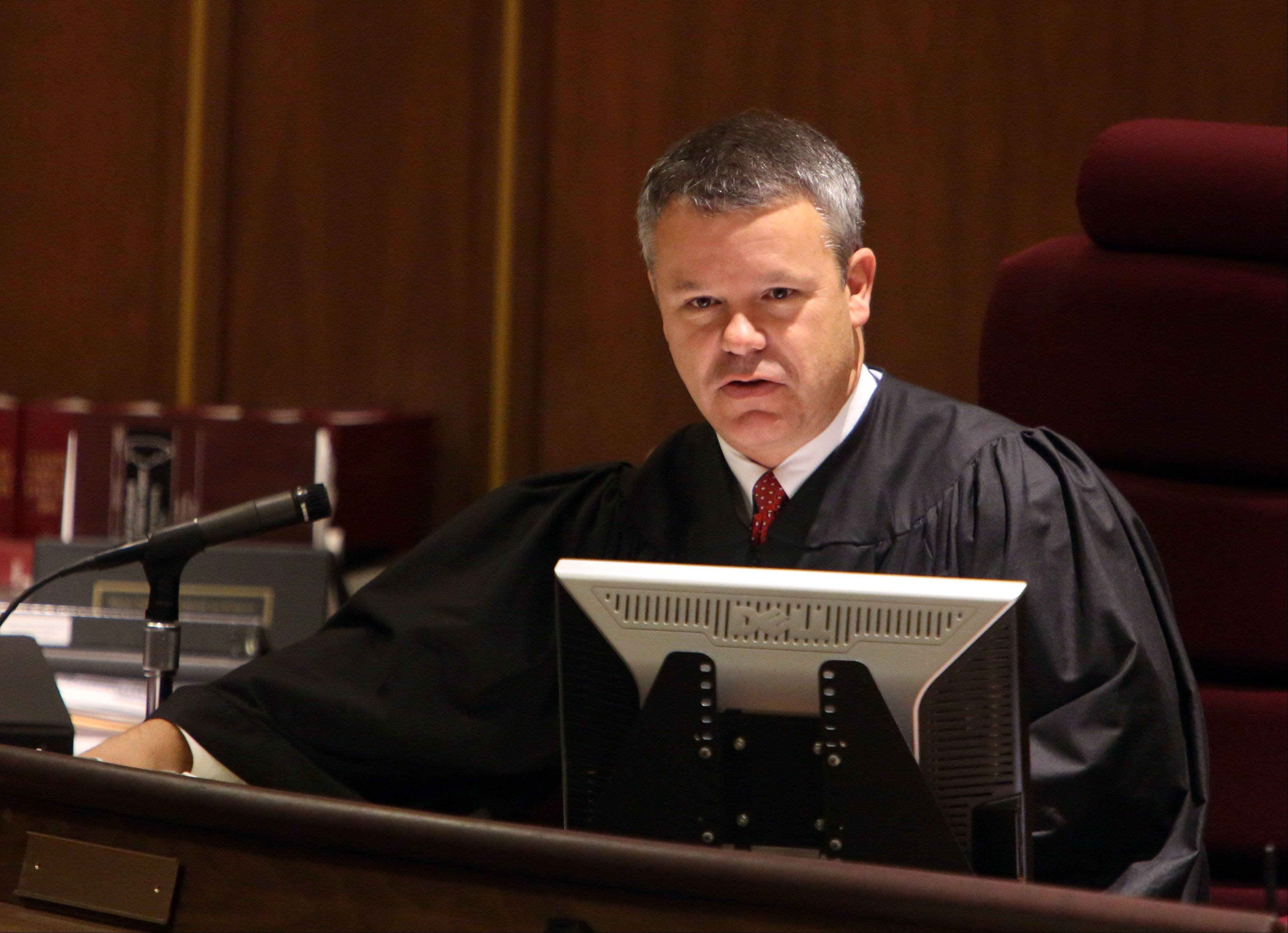 Kane County Judge Clinton Hull conducts court during the sentencing hearing for David Hatyina.