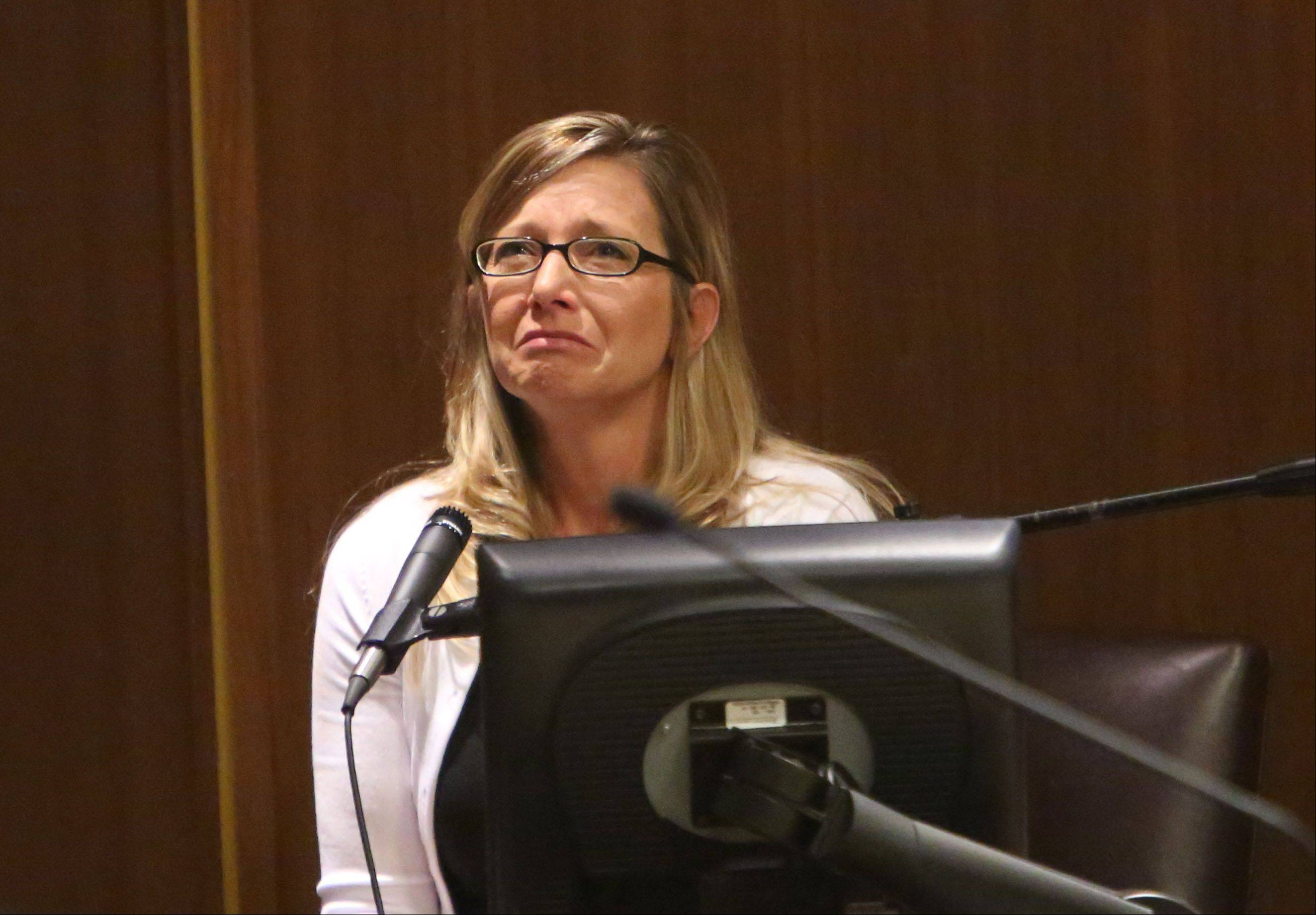 Renee Melbourn of Bartlett, longtime girlfriend of David Hatyina, cries during questioning at the sentencing hearing.