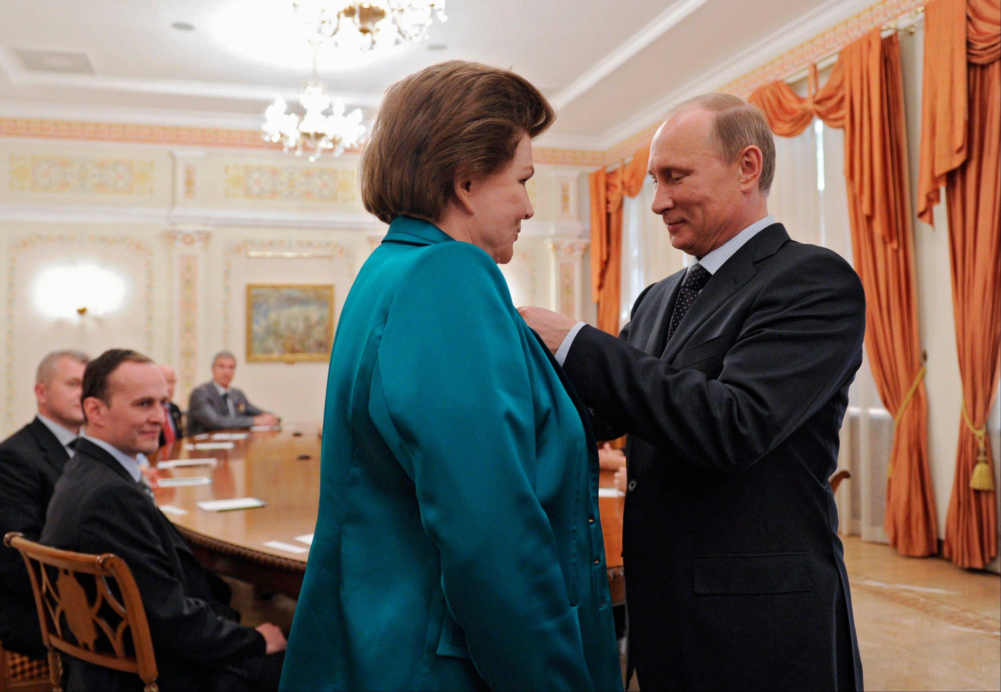 Russian President Vladimir Putin awards cosmonaut Valentina Tereshkova, the first woman in space, with the Order of Alexander Nevsky Friday in the Novo-Ogaryovo residence outside Moscow.