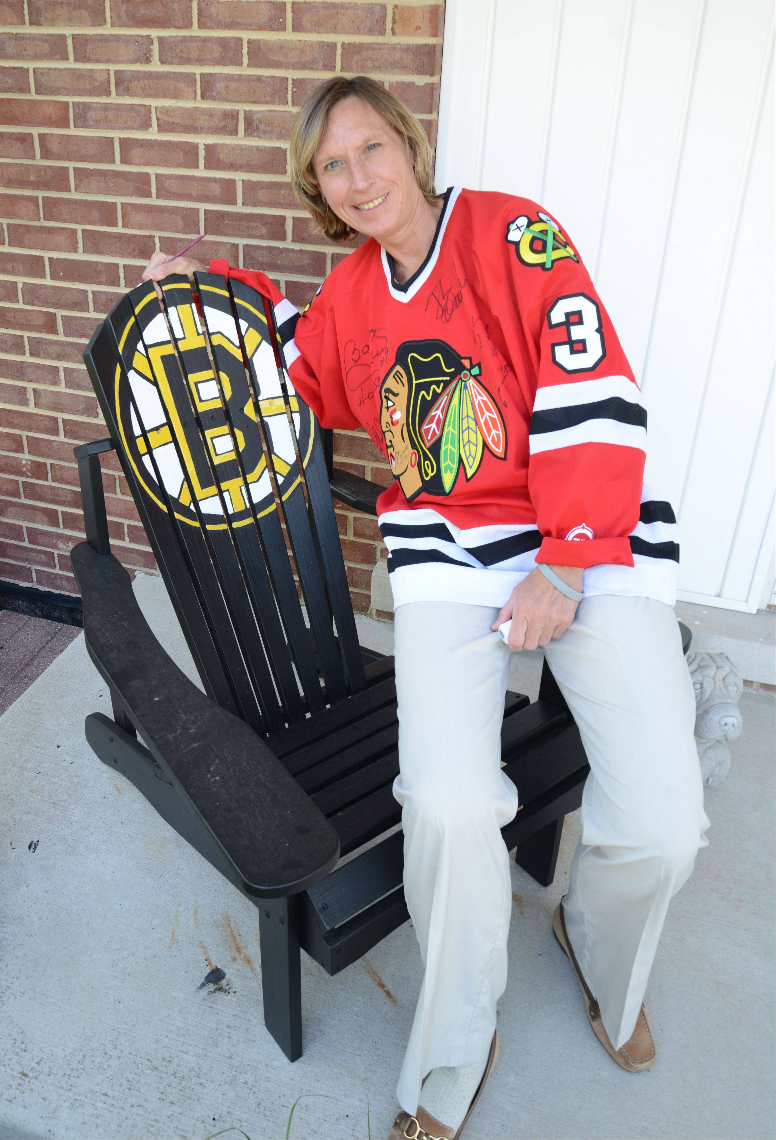 Lee Ann Stawczyk paid homage to her second-favorite team by painting the Bruins logo on this chair. She says the Hawks-Bruins matchup is the 'ultimate Stanley Cup.'