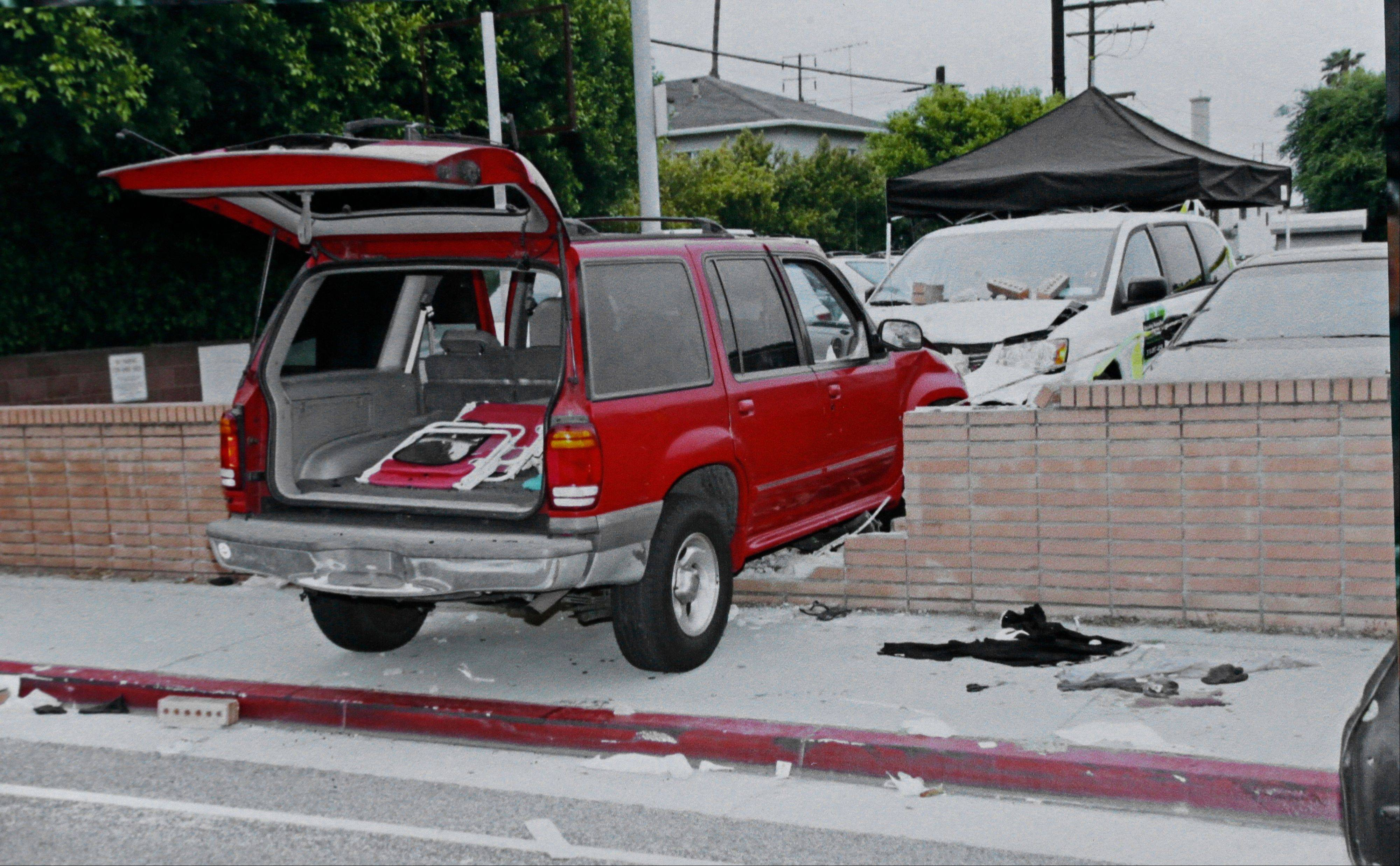 An evidence photo showing the SUV in which Carlos Franco and his daughter Marcela Franco were shot and killed is among several new evidence photos of the June 9 shooting rampage by John Zawahri that were released by the Santa Monica, Calif., Police Department at a news conference Thursday