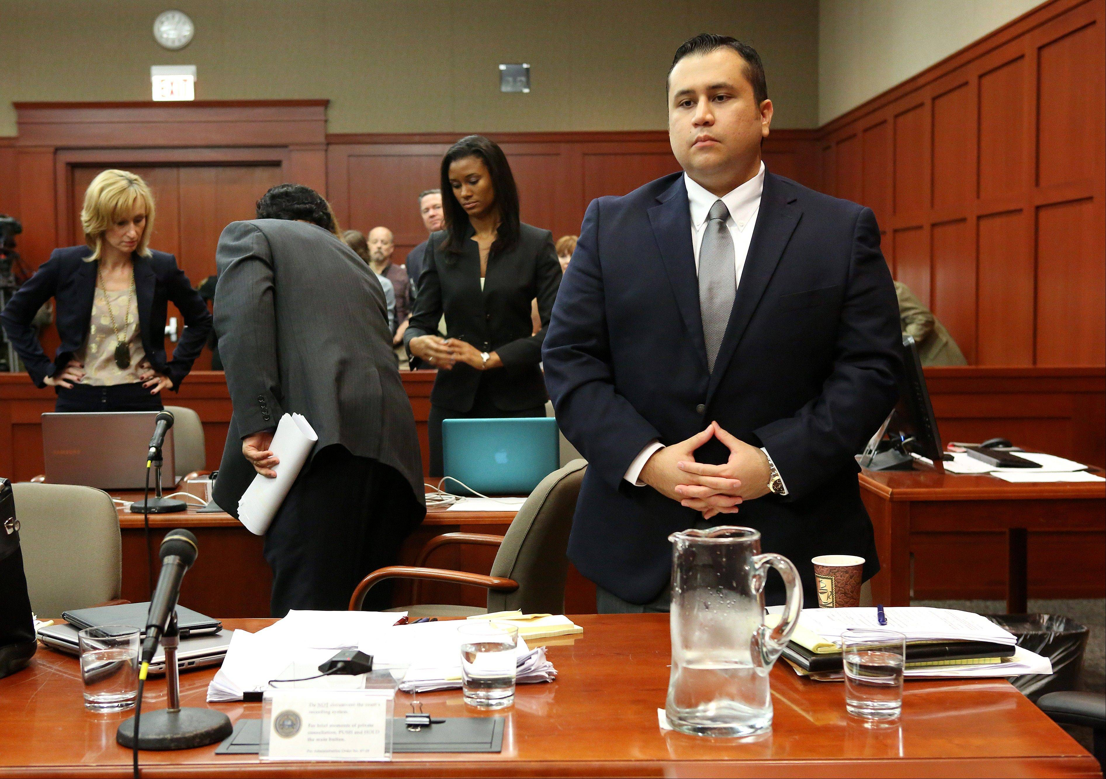 George Zimmerman stands in Seminole circuit court prior to the fourth day of his trial, in Sanford, Fla., Thursday.