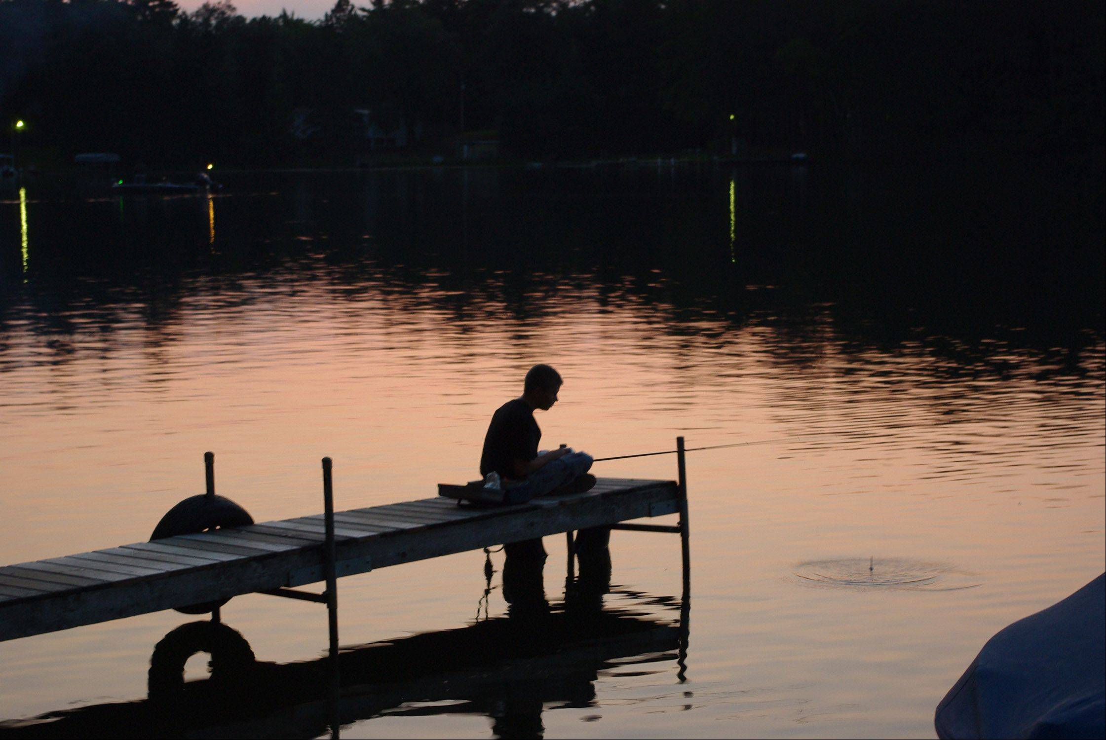 Aric Jones chills out while fishing on Little Saint Germain Lake in Wisconsin while on vacation in 2011.