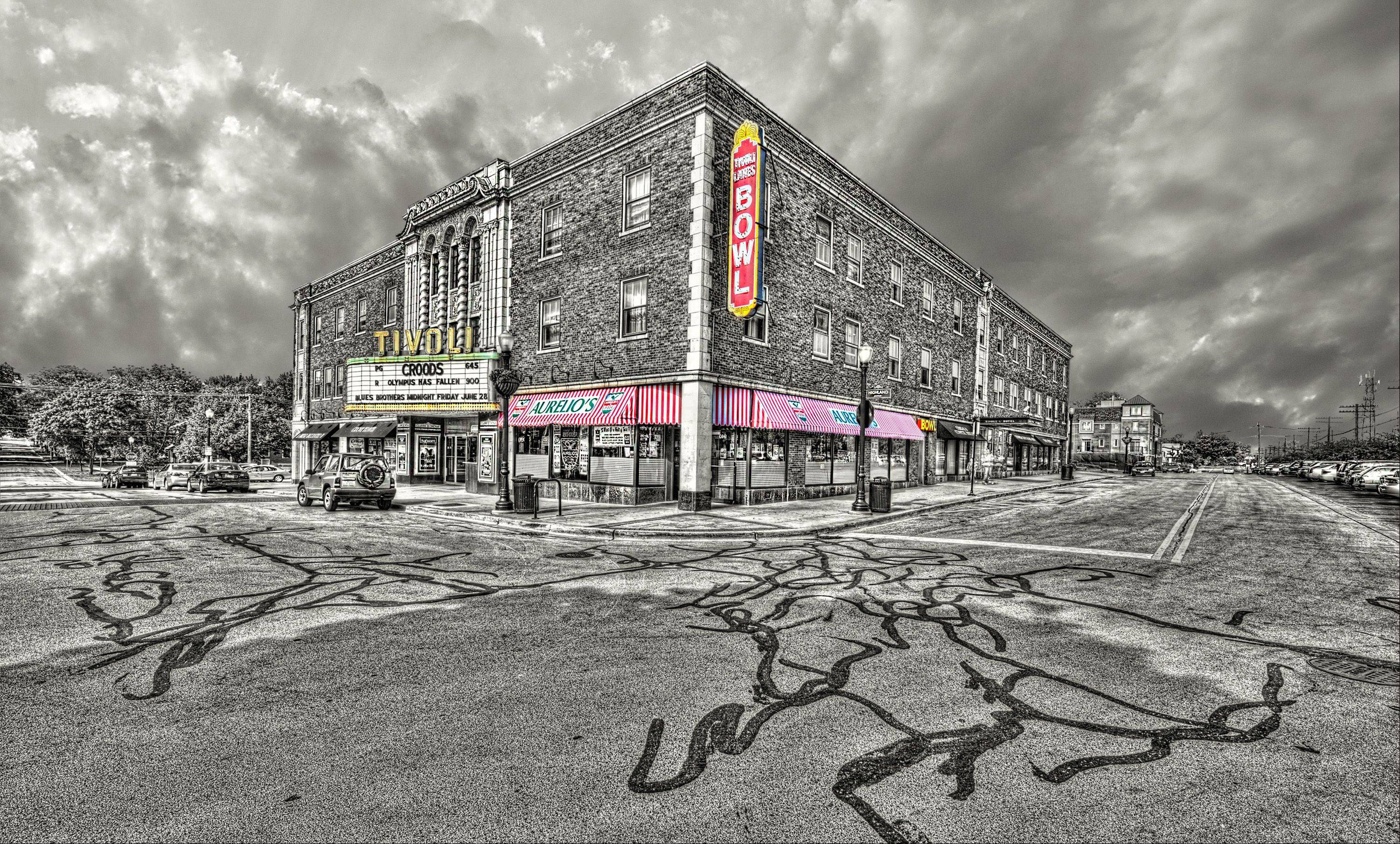 I shot this photo of the Tivoli Theatre in downtown Downers Grove. It was shot originally in HDR to capture the tonal quality then converted to B&W. The original sky was a flat blue and there were lots of water spots on the lens from the previous shoot, so masking out the sky seemed like the logical thing to do. I'll admit to spending a great deal of time on the detail on the front of the theater, the signage in the pizza shop and the house at the end of the block. The more I stared at this, the little things popped out and needed enhancement. The original image size out of the camera was a 36mb file, shot with a Nikon D800E and a Nikor 14-24mm lens.
