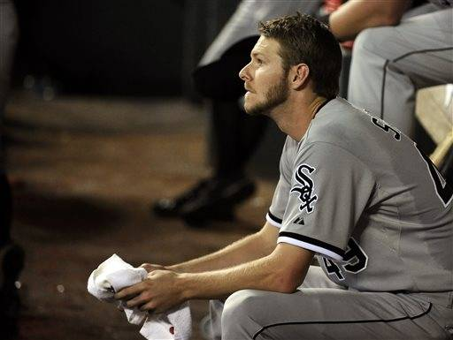 Chris Sale struck out a season-high 14 batters and didn't allow an earned run against the Houston Astros on Friday night. But instead of celebrating a win, a pair of errors by Alexei Ramirez left the Chicago White Sox with another road loss and left the pitcher to console his shortstop. Erik Bedard pitched six solid innings, and Jose Altuve hit a go-ahead RBI single to give the Astros a 2-1 win.