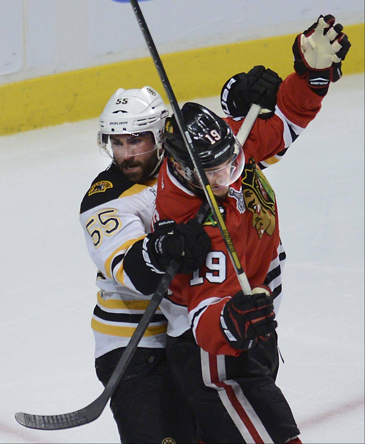 Boston Bruins defenseman Johnny Boychuk wraps how stick around Blackhawks center Jonathan Toews' neck in front of the net in the second overtime during Game 1 of the Stanley Cup Finals Wednesday at the United Center in Chicago. No penalty was called.